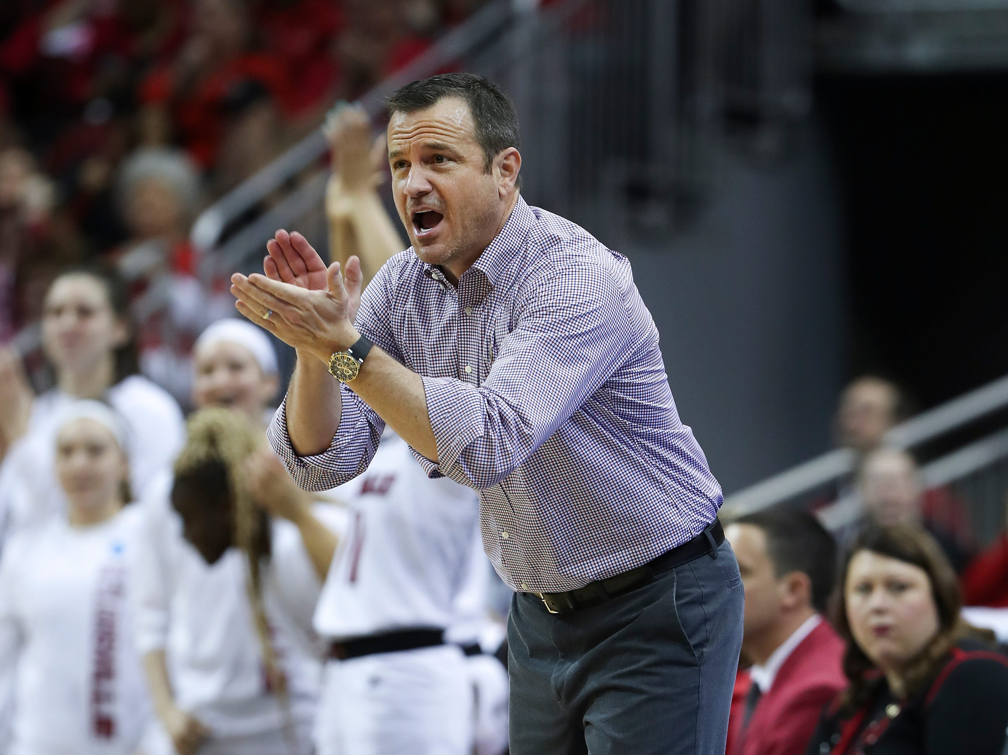 U of L head coach Jeff Walz applauded his team against Michigan in the second round of their NCAA Tournament game at the Yum Center.  Mar. 24, 2019