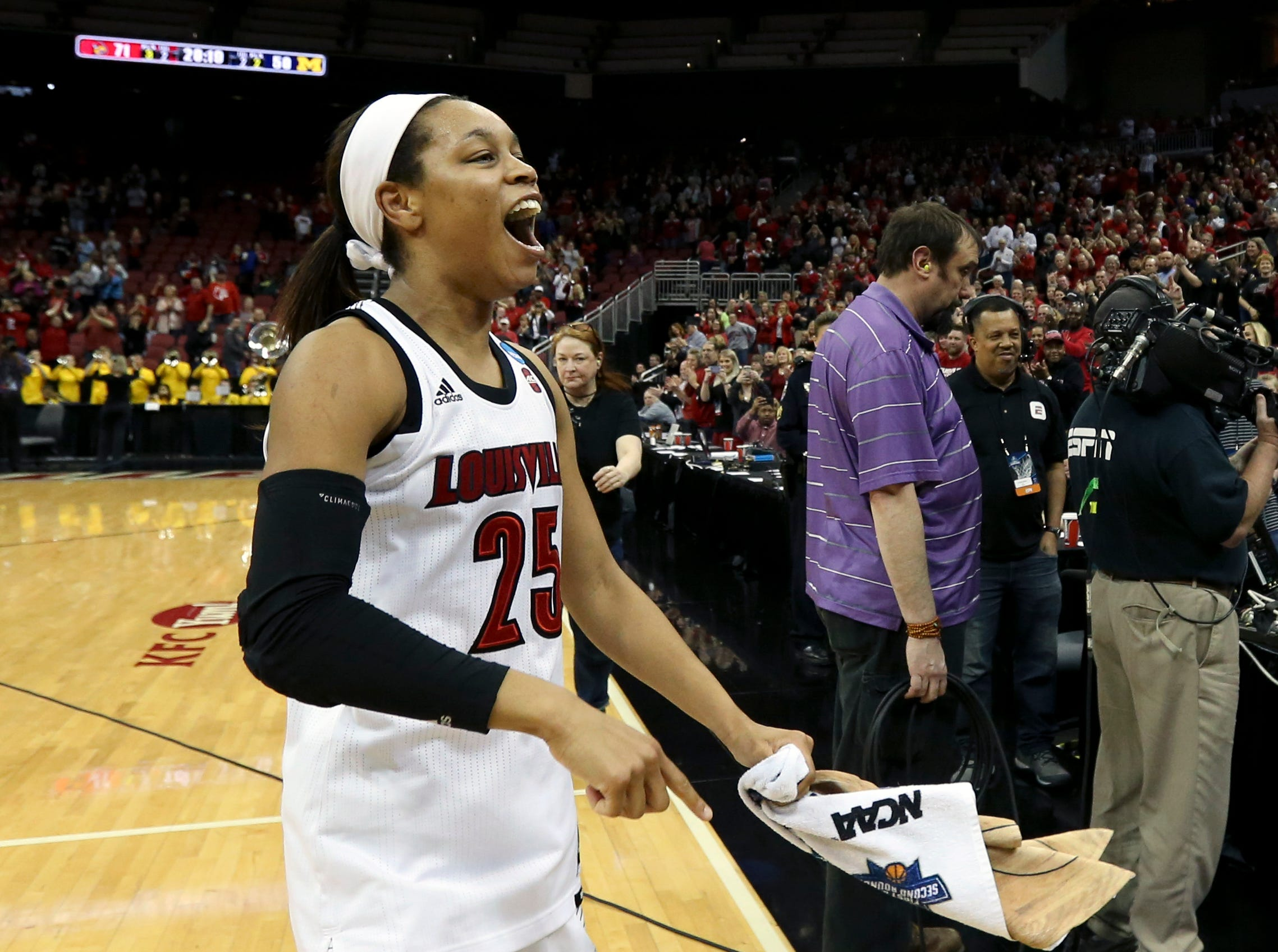 Louisville's Asia Durr does a celebration lap after the Cardinals punch their ticket to the Sweet 16 by beating Michigan at the KFC Yum Center on March 24.