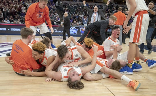 Celebration after Silver Creek High School defeated Culver Academies 52-49 in the Class 3S Boys Basketball State Final, Bankers Life Fieldhouse, Indianapolis, Saturday.