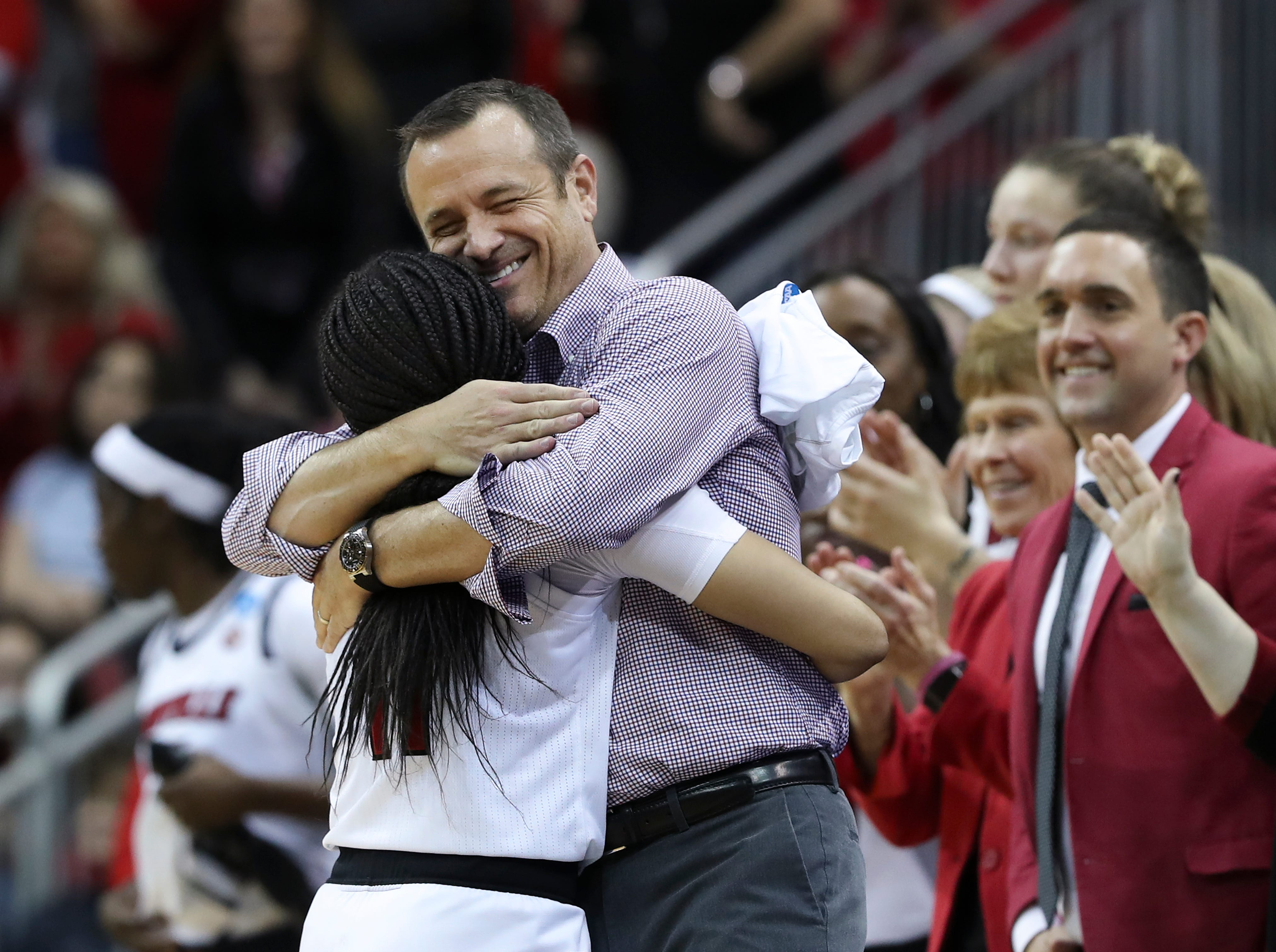 U of L head coach Jeff Walz embraced senior Arica Carter (11) after their 71-50 defeat of Michigan in the second round of their NCAA Tournament game at the Yum Center.  They advance to the Sweet 16 in the Albany regional.  It would be her last game as a Cardinal in the Yum Center. Mar. 24, 2019.