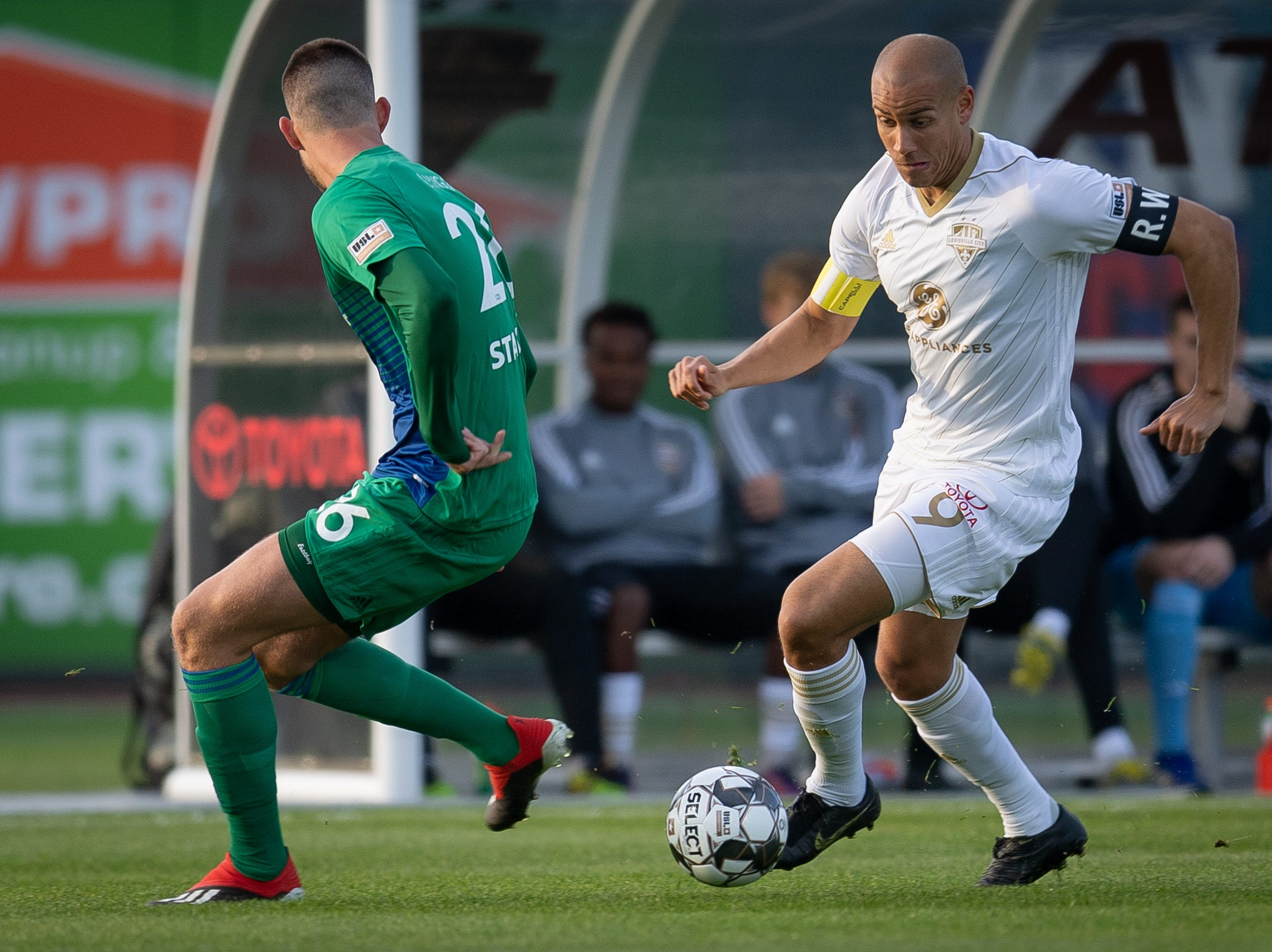 Louisville City FC forward Luke Spencer (9) plays against Hartford Athletic Nikolaj Lyngo during the season opening match in Louisville, Ky., Saturday, March 23, 2019.