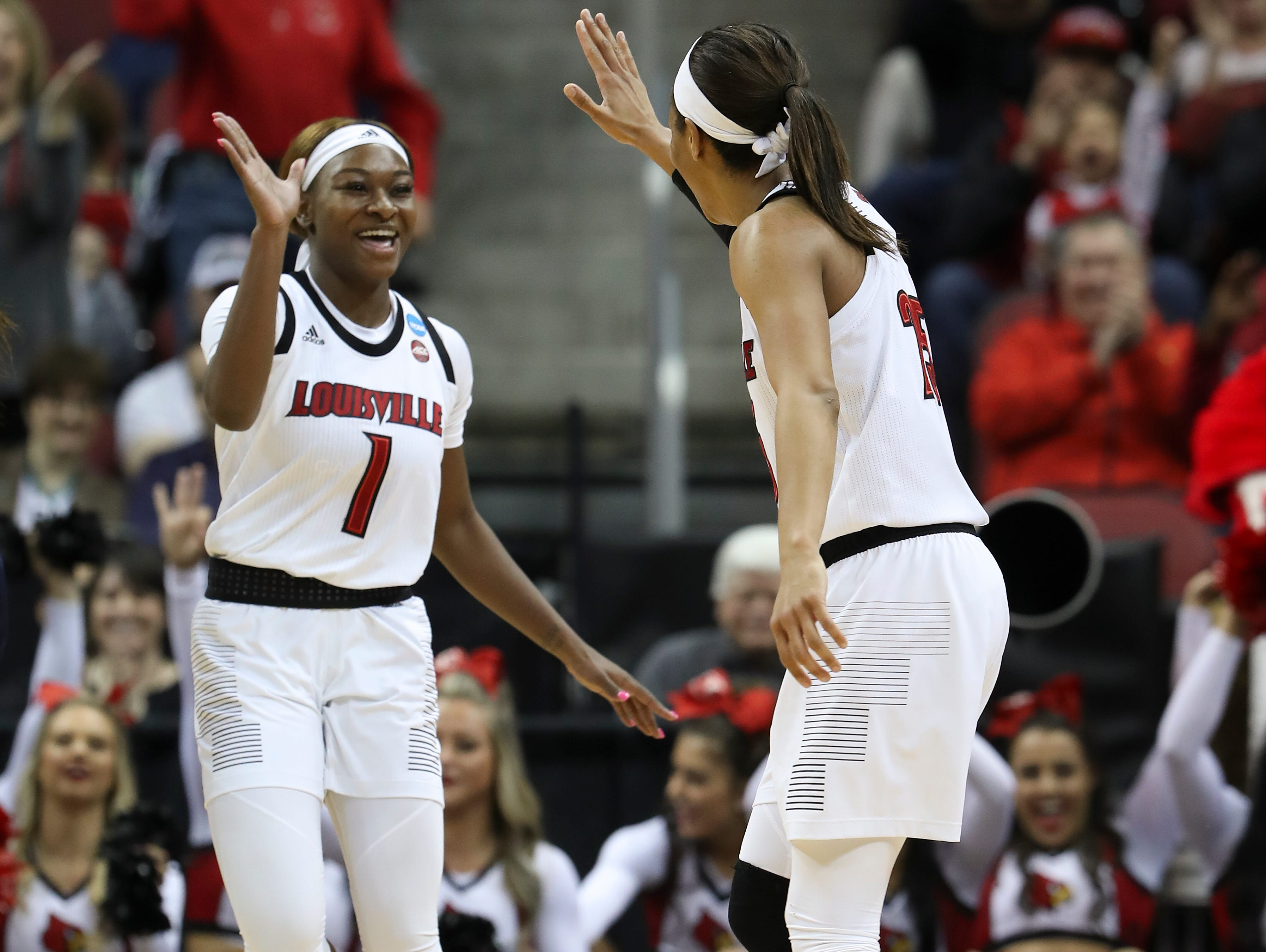 U of L's Dana Evans (1) and Asia Durr (25) celebrate a run against Michigan in the second round of their NCAA Tournament game at the Yum Center.  Mar. 24, 2019