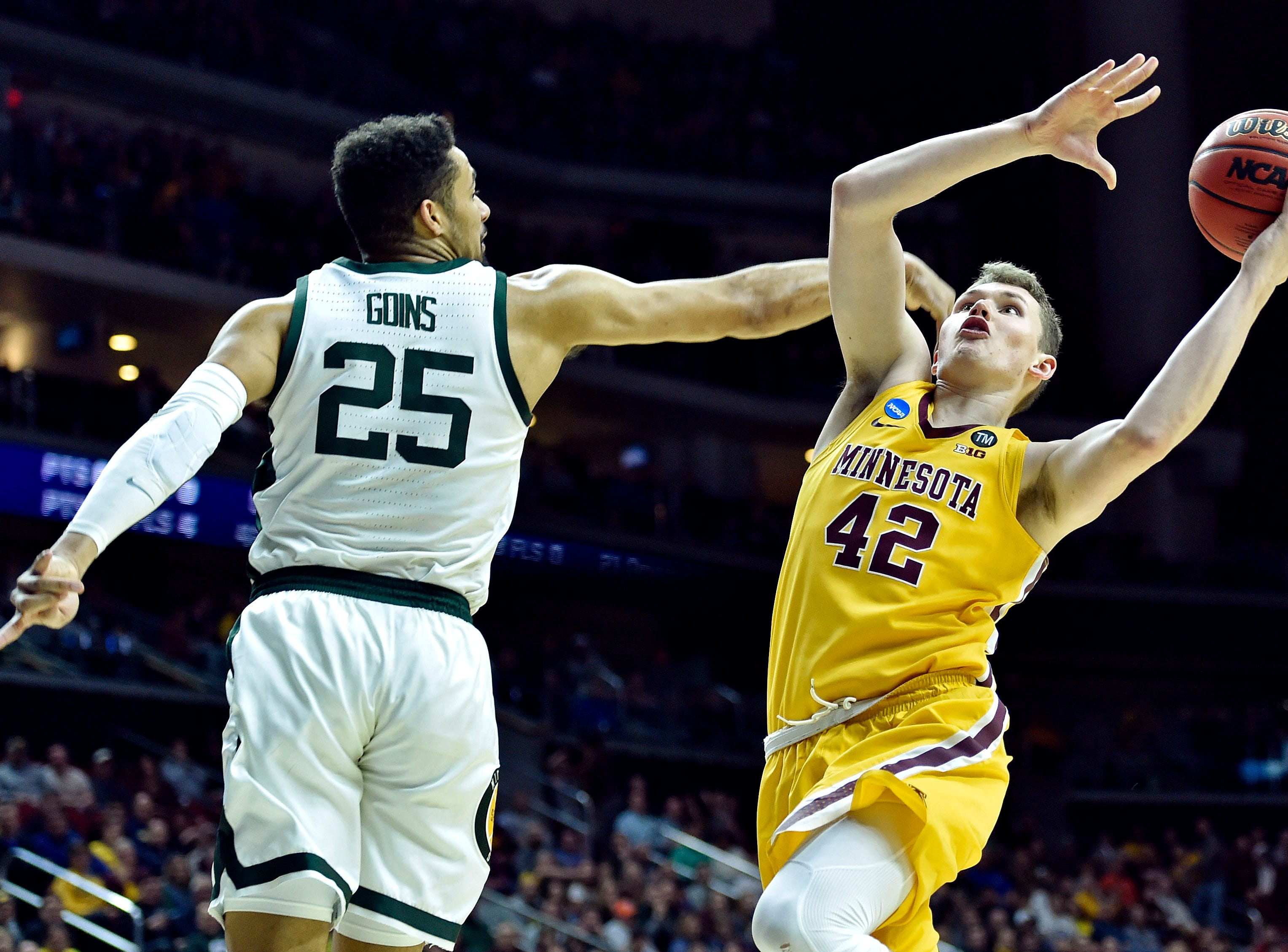 Mar 23, 2019; Des Moines, IA, United States; Minnesota Golden Gophers forward Michael Hurt (42) shoots the ball against Michigan State Spartans forward Kenny Goins (25) during the second half in the second round of the 2019 NCAA Tournament at Wells Fargo Arena. Mandatory Credit: Jeffrey Becker-USA TODAY Sports