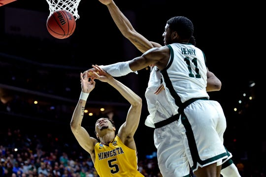 Mar 23, 2019; Des Moines, IA, United States; Minnesota Golden Gophers guard Amir Coffey (5) shoots the ball against Michigan State Spartans forward Aaron Henry (11) during the second half in the second round of the 2019 NCAA Tournament at Wells Fargo Arena. Mandatory Credit: Jeffrey Becker-USA TODAY Sports