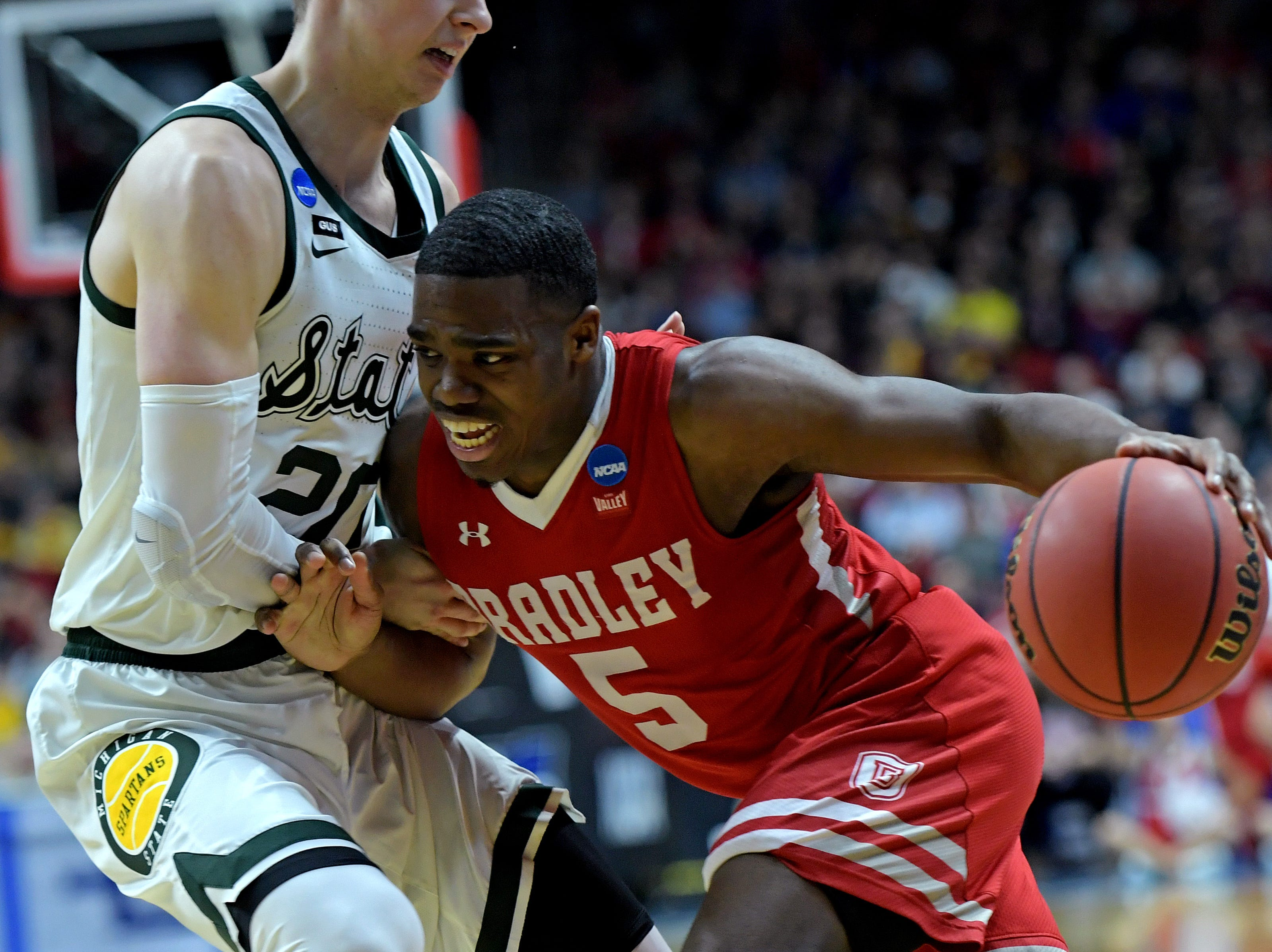 Mar 21, 2019; Des Moines, IA, United States; Bradley Braves guard Darrell Brown (5) drives to the basket against Michigan State Spartans guard Matt McQuaid (20) during the first half in the first round of the 2019 NCAA Tournament at Wells Fargo Arena. Mandatory Credit: Steven Branscombe-USA TODAY Sports
