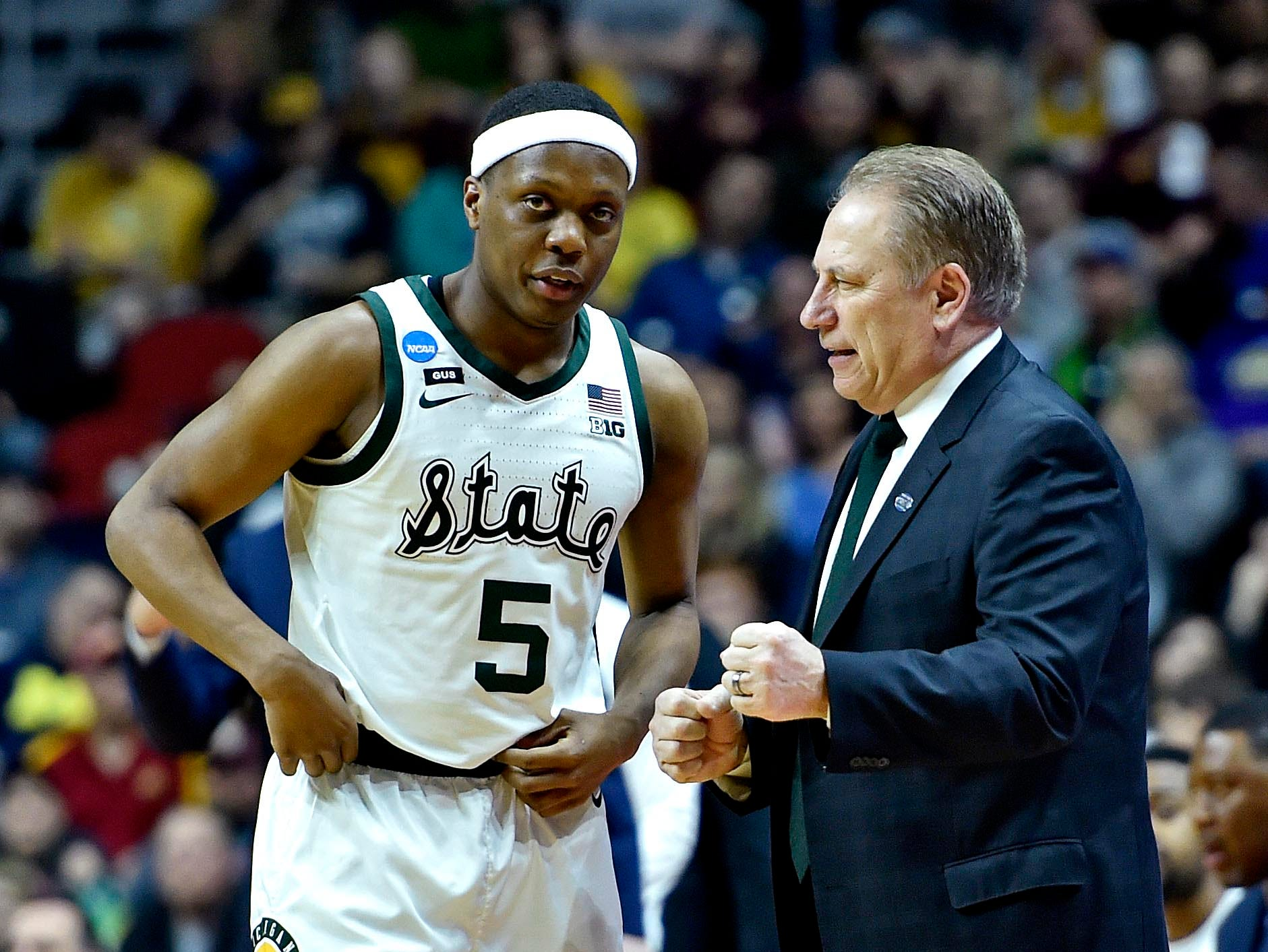 Mar 23, 2019; Des Moines, IA, United States; Michigan State Spartans head coach Tom Izzo talks with guard Cassius Winston (5) during the first half against the Minnesota Golden Gophers in the second round of the 2019 NCAA Tournament at Wells Fargo Arena. Mandatory Credit: Jeffrey Becker-USA TODAY Sports
