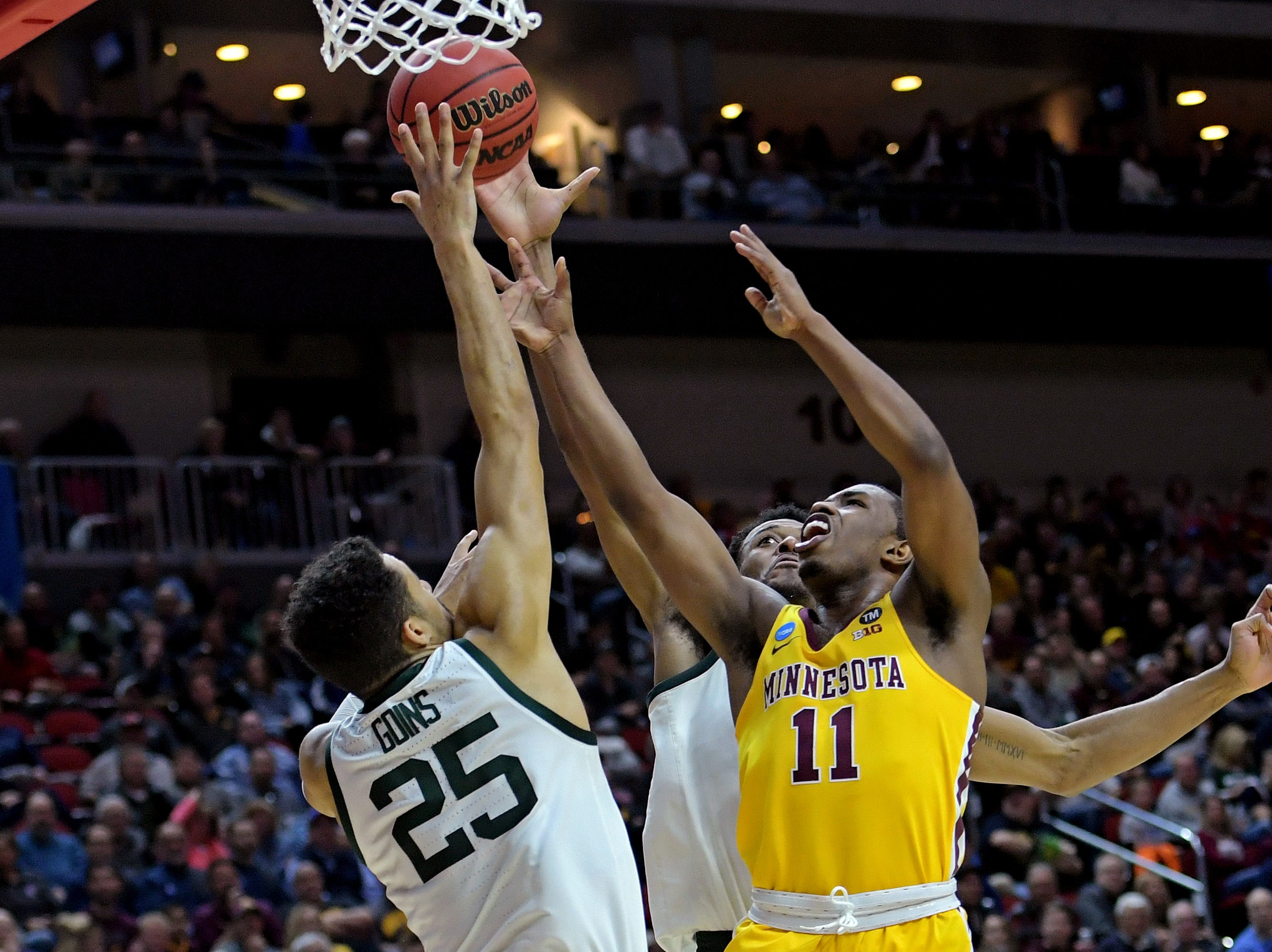 Mar 23, 2019; Des Moines, IA, United States; Minnesota Golden Gophers guard Isaiah Washington (11) shoots the ball against Michigan State Spartans forward Kenny Goins (25) during the first half in the second round of the 2019 NCAA Tournament at Wells Fargo Arena. Mandatory Credit: Steven Branscombe-USA TODAY Sports