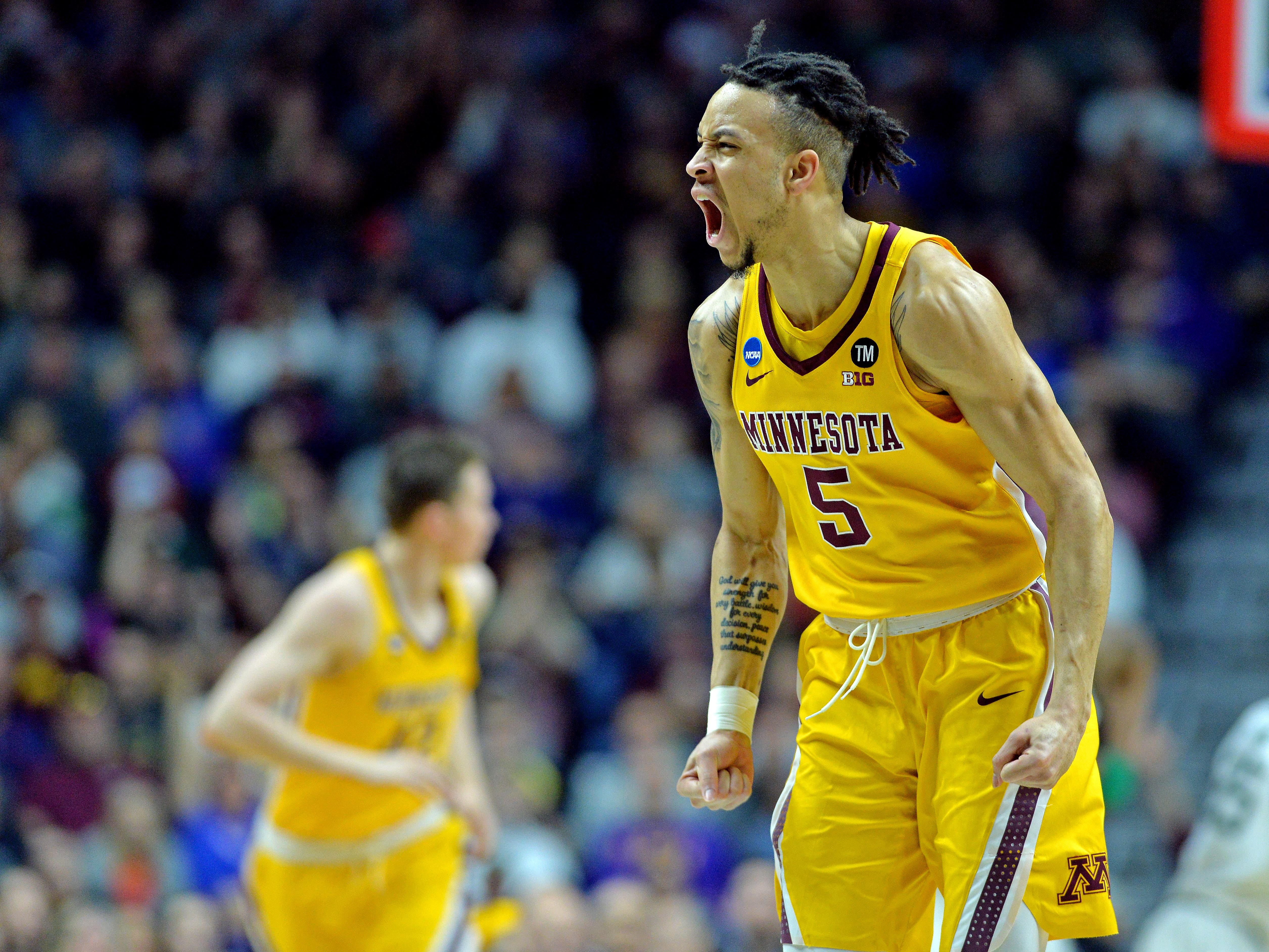 Mar 23, 2019; Des Moines, IA, United States; Minnesota Golden Gophers guard Amir Coffey (5) reacts during the first half against the Michigan State Spartans in the second round of the 2019 NCAA Tournament at Wells Fargo Arena. Mandatory Credit: Jeffrey Becker-USA TODAY Sports