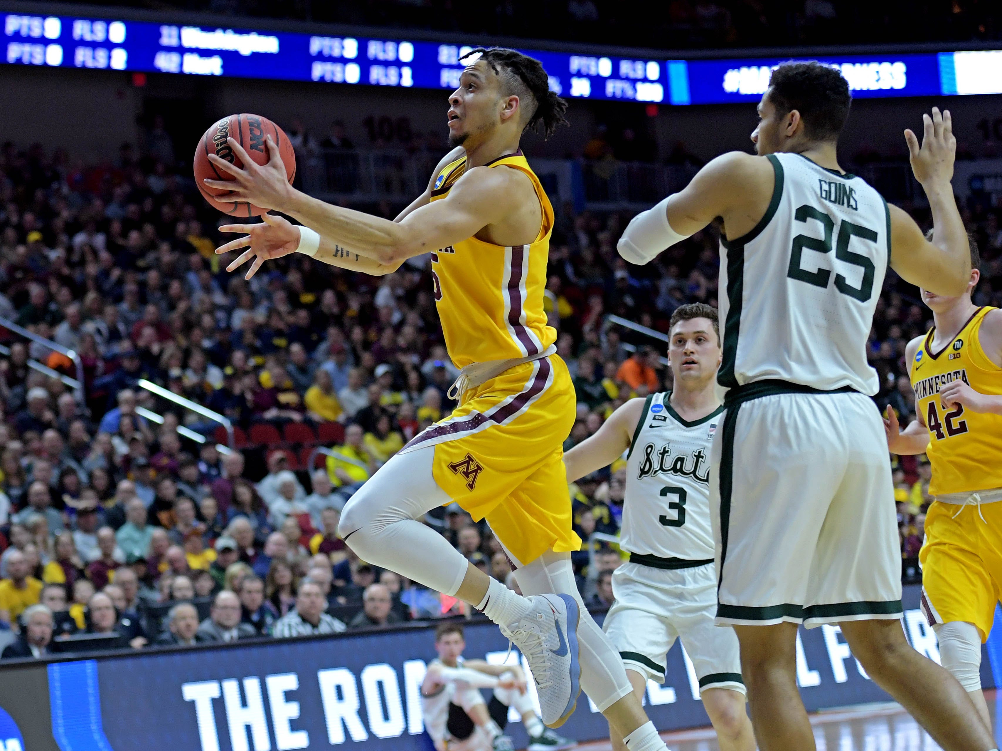 Mar 23, 2019; Des Moines, IA, United States; Minnesota Golden Gophers guard Amir Coffey (5) shoots the ball against Michigan State Spartans forward Kenny Goins (25) in the second round of the 2019 NCAA Tournament at Wells Fargo Arena. Mandatory Credit: Steven Branscombe-USA TODAY Sports