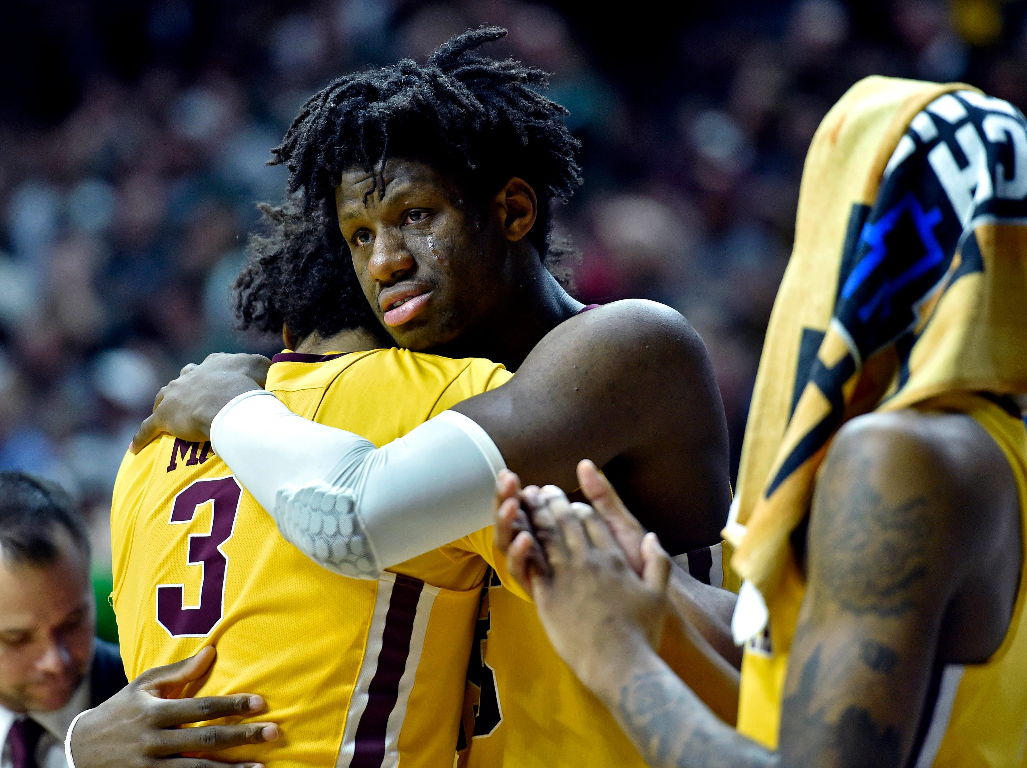 Mar 23, 2019; Des Moines, IA, United States; Minnesota Golden Gophers forward Jordan Murphy (3) hugs center Daniel Oturu (25) during the second half against the Michigan State Spartans in the second round of the 2019 NCAA Tournament at Wells Fargo Arena. Mandatory Credit: Jeffrey Becker-USA TODAY Sports