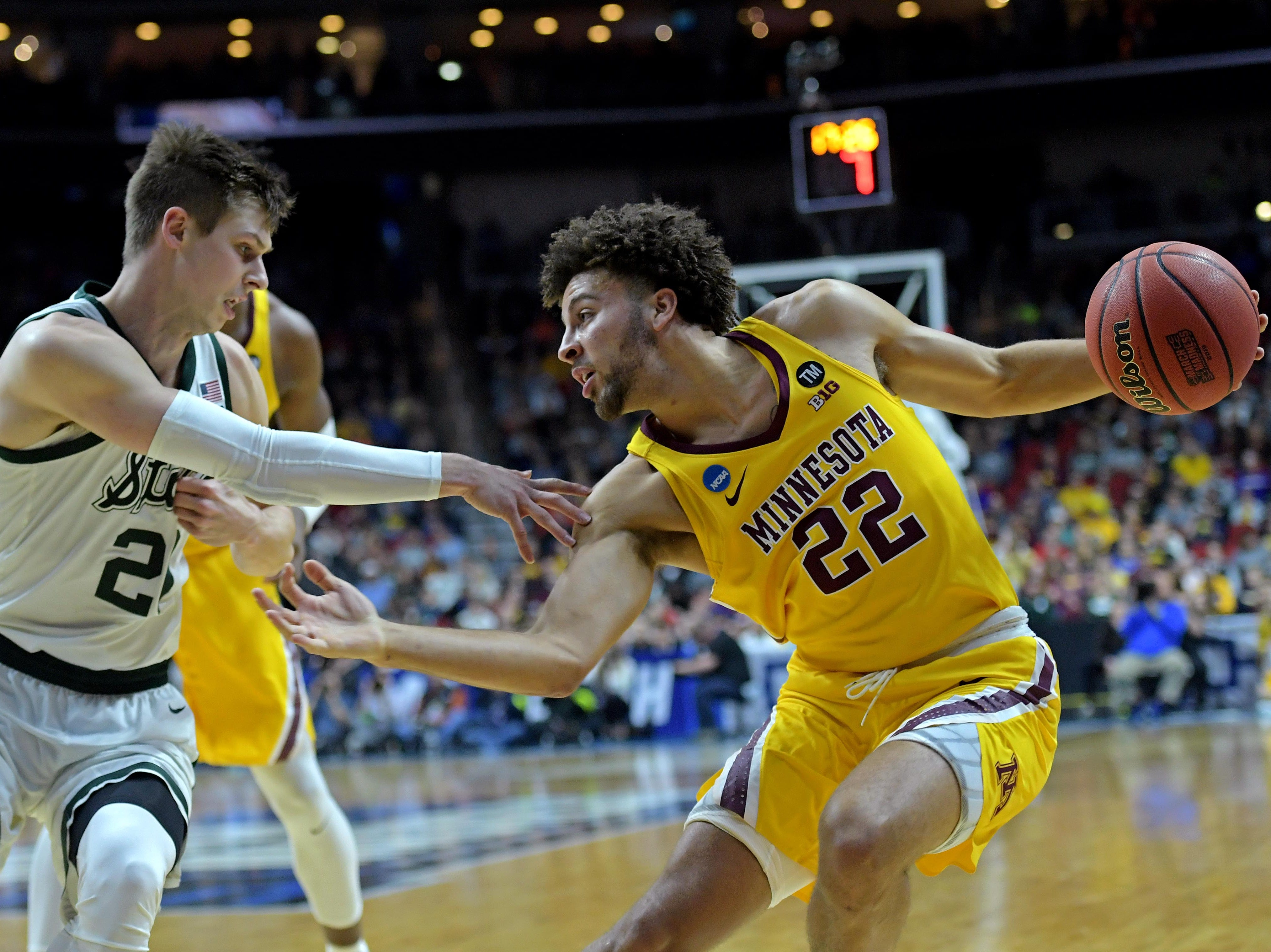 Mar 23, 2019; Des Moines, IA, United States; Minnesota Golden Gophers guard Gabe Kalscheur (22) drives to the basket against Michigan State Spartans guard Matt McQuaid (20) during the first half in the second round of the 2019 NCAA Tournament at Wells Fargo Arena. Mandatory Credit: Steven Branscombe-USA TODAY Sports