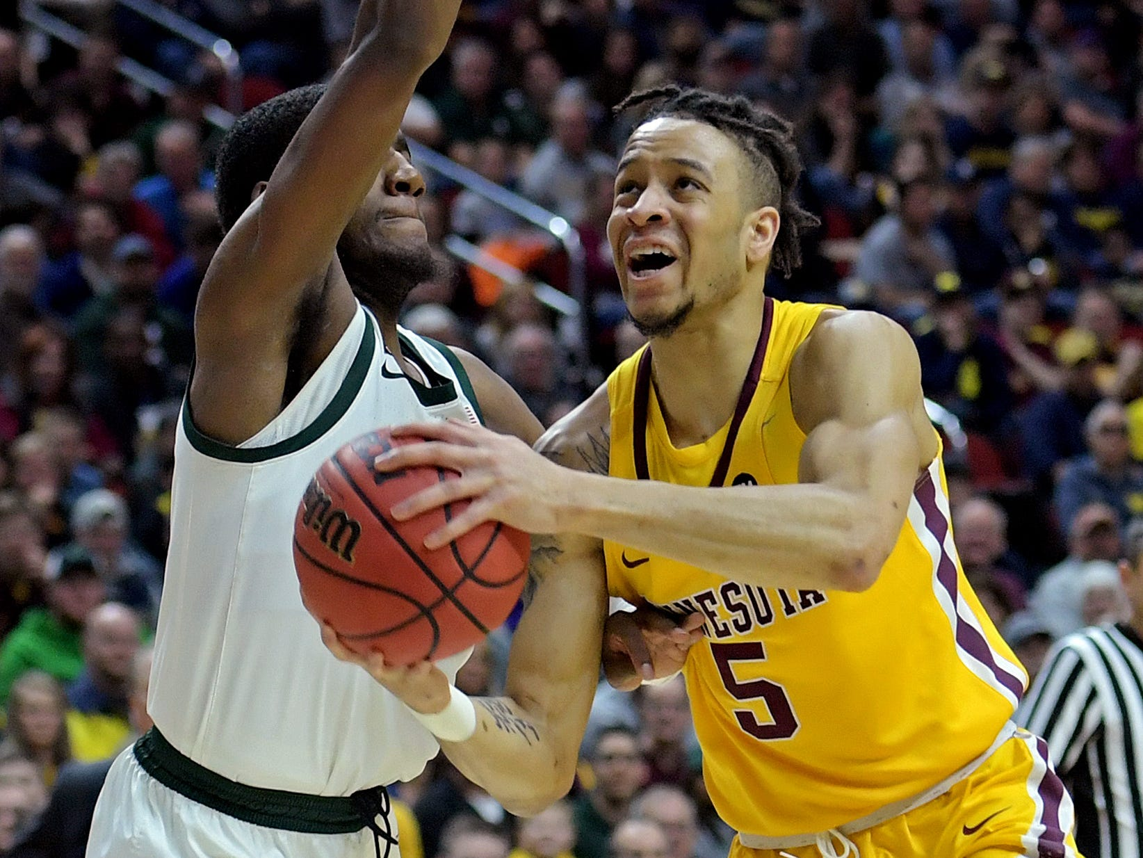 Mar 23, 2019; Des Moines, IA, United States; Minnesota Golden Gophers guard Amir Coffey (5) drives to the basket against Michigan State Spartans forward Aaron Henry (11) during the first half in the second round of the 2019 NCAA Tournament at Wells Fargo Arena. Mandatory Credit: Steven Branscombe-USA TODAY Sports