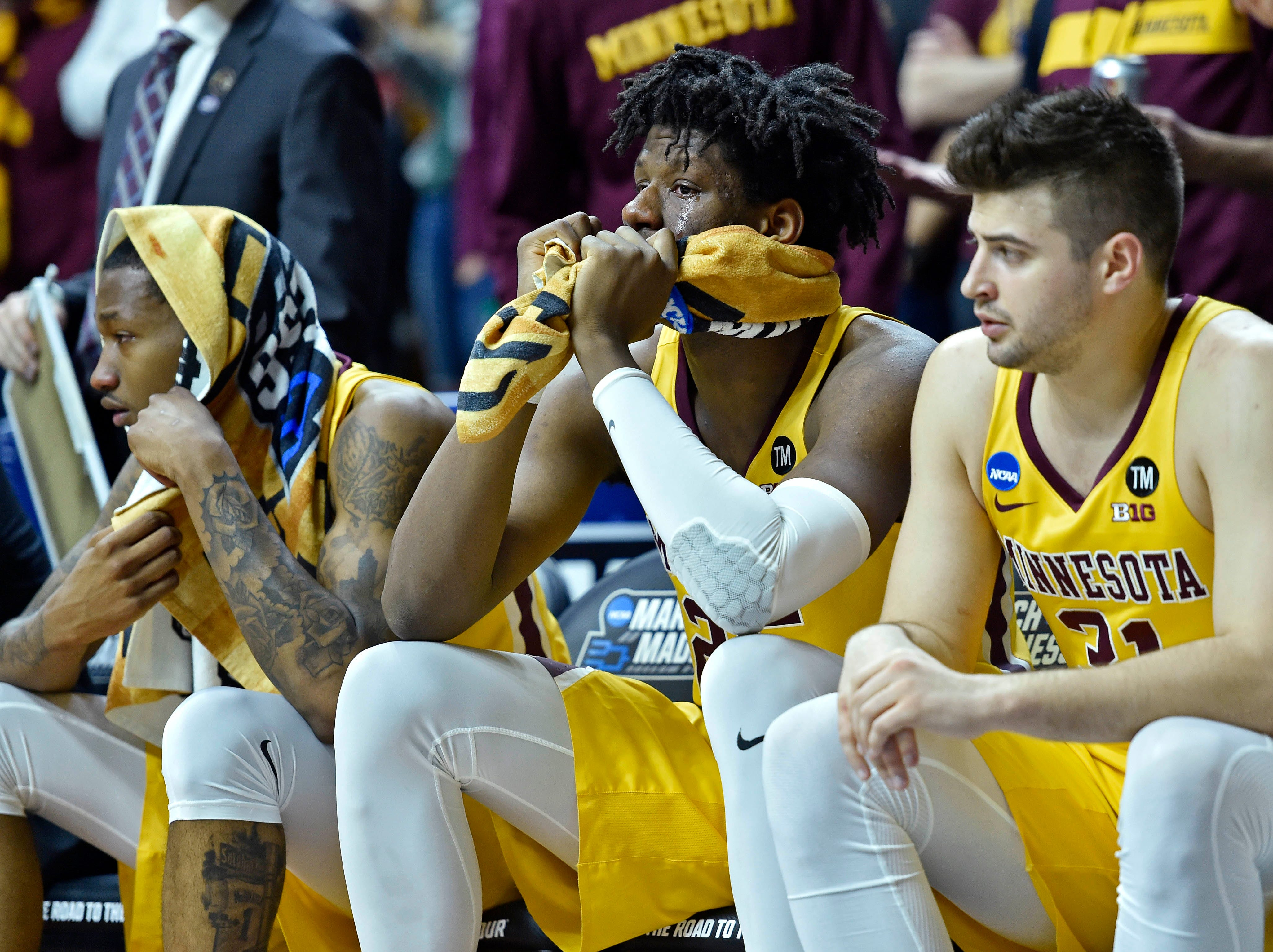 Mar 23, 2019; Des Moines, IA, United States; Minnesota Golden Gophers center Daniel Oturu (25) reacts on the bench during the second half against the Michigan State Spartans in the second round of the 2019 NCAA Tournament at Wells Fargo Arena. Mandatory Credit: Jeffrey Becker-USA TODAY Sports