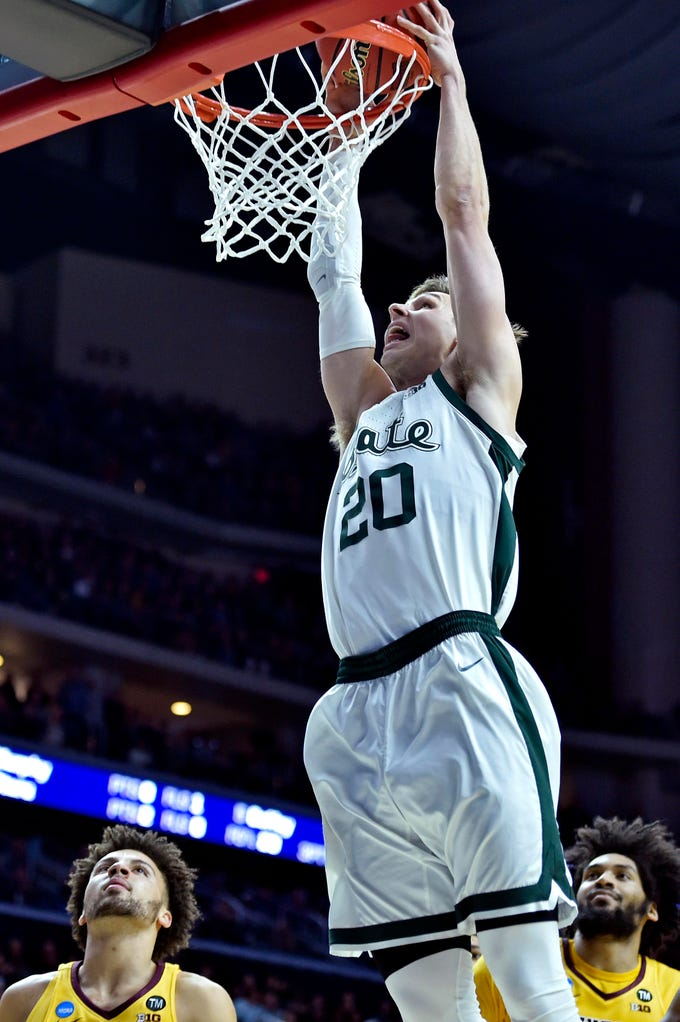 Mar 23, 2019; Des Moines, IA, United States; Michigan State Spartans guard Matt McQuaid (20) dunks the ball against the Minnesota Golden Gophers during the first half in the second round of the 2019 NCAA Tournament at Wells Fargo Arena. Mandatory Credit: Jeffrey Becker-USA TODAY Sports