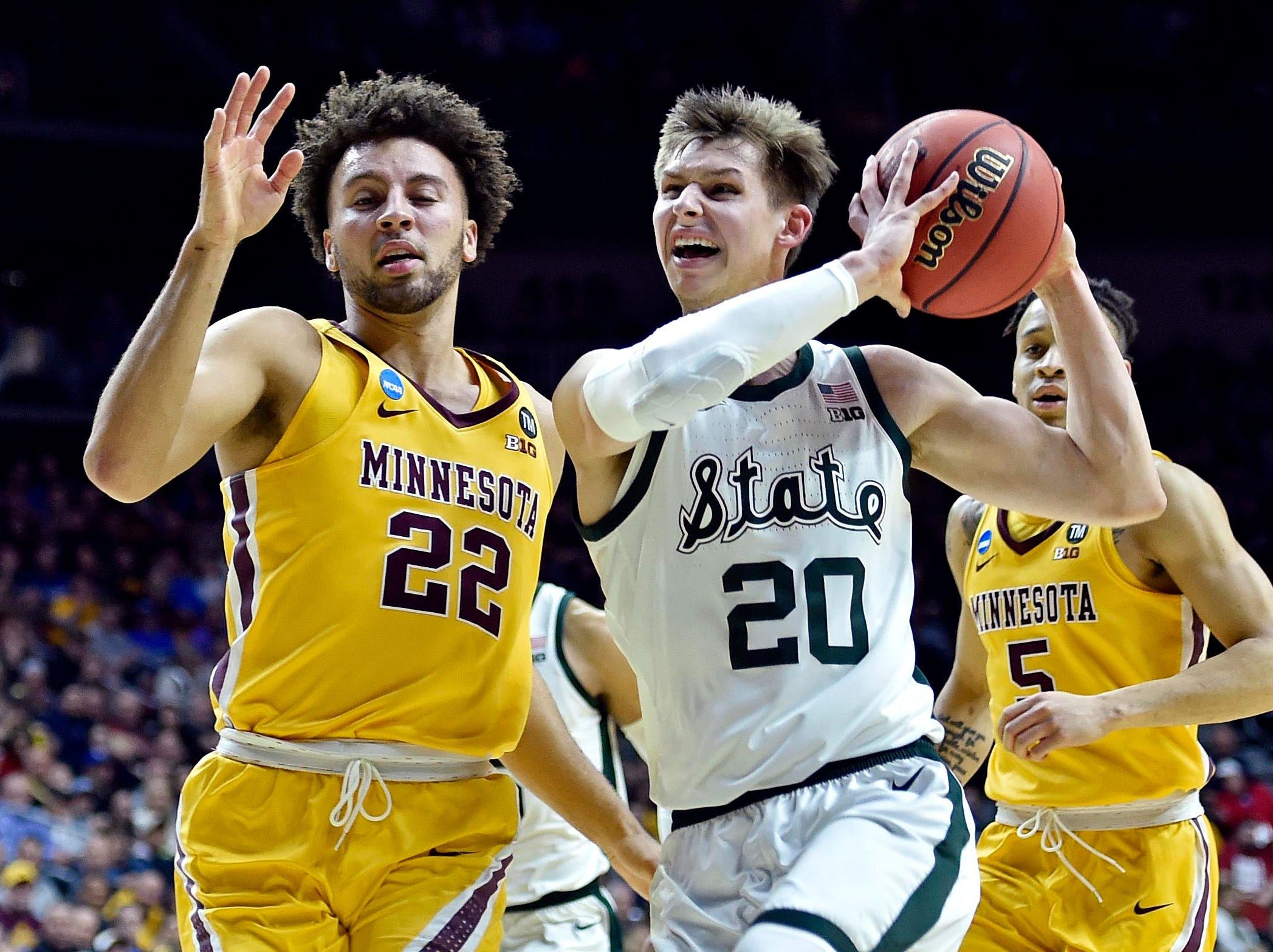 Mar 23, 2019; Des Moines, IA, United States; Michigan State Spartans guard Matt McQuaid (20) drives to the basket against Minnesota Golden Gophers guard Gabe Kalscheur (22) during the second half in the second round of the 2019 NCAA Tournament at Wells Fargo Arena. Mandatory Credit: Jeffrey Becker-USA TODAY Sports