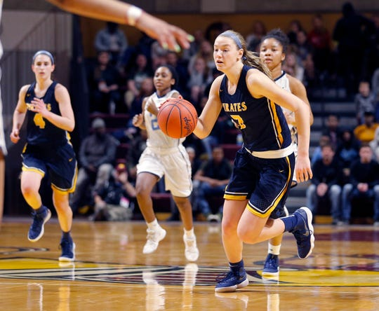 Pewamo-Westphalia's Hannah Spitzley, right, drives against Flint Hamady, Saturday, March 23, 2019, in Grand Rapids, Mich. P-W won 40-33.