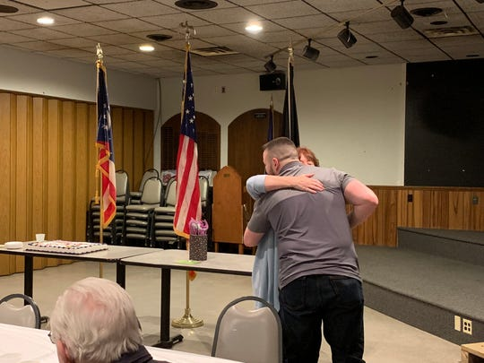 Mentor Coordinator Lori Fouhrman embraces veteran volunteer Brett Collins during the Mentor Appreciation Dinner on March 24, 2019.