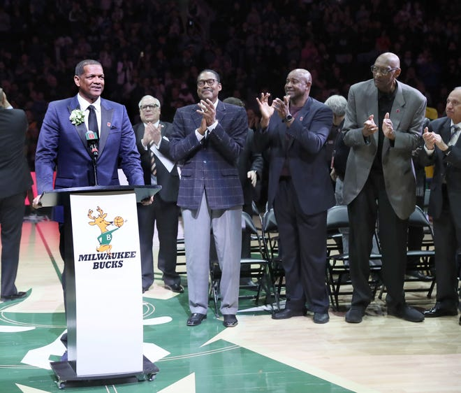 Marques Johnson speaks to the Fiserv Forum crowd during the ceremony to retire his No. 8 jersey on Sunday.
