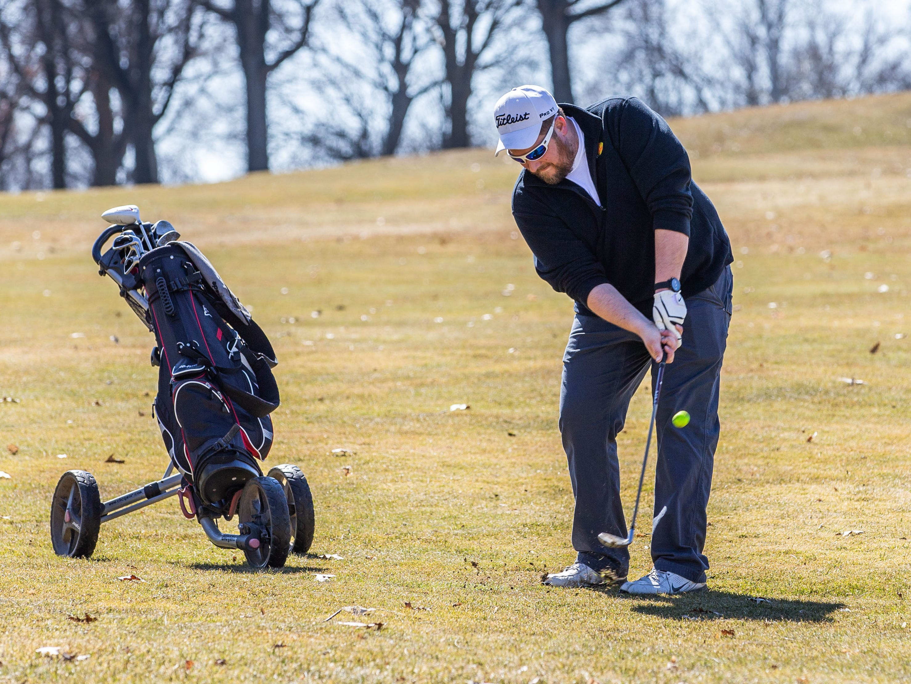 Todd Gillman of New Berlin chips onto a green at Greenfield Park Golf Course on Saturday, March 23, 2019. Warm sunny weather lured many enthusiasts outside to enjoy the game.