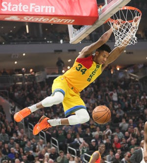 Giannis Antetokounmpo scores an easy bucket, one of nine dunks he had Sunday against the Cavaliers.