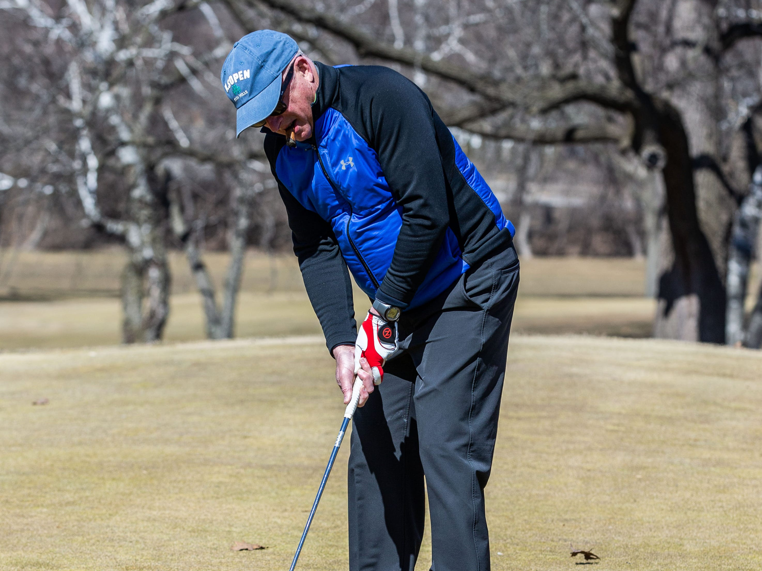 Chris Clemens of Menomonee Falls plays a round at Greenfield Park Golf Course on Saturday, March 23, 2019. Warm sunny weather lured many enthusiasts outside to enjoy the game.