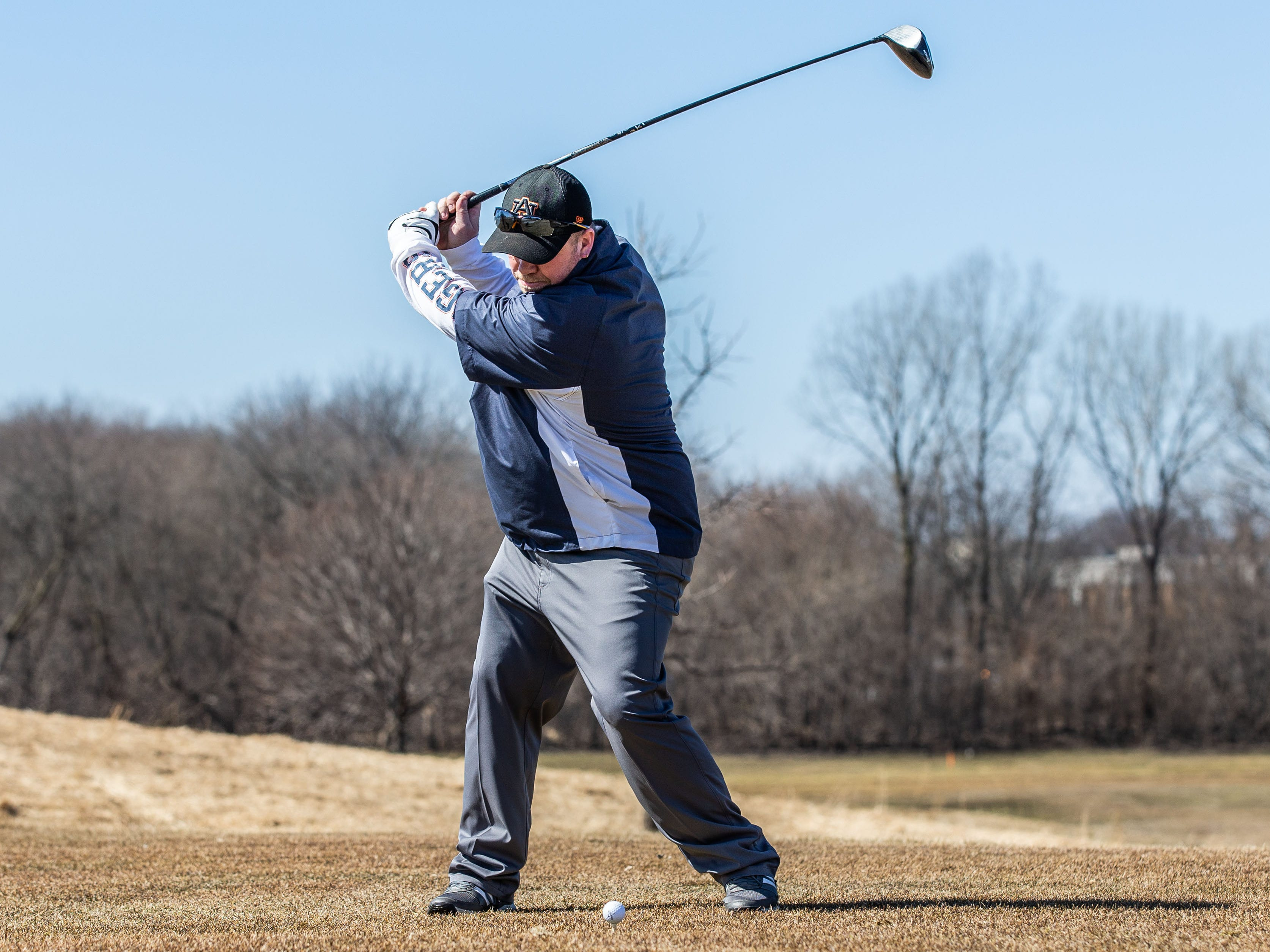Mark Jeffers of Waukesha drives off a tee at Moor Downs Golf Course in Waukesha on Saturday, March 23, 2019. Warm sunny weather lured many enthusiasts outside to enjoy the game.