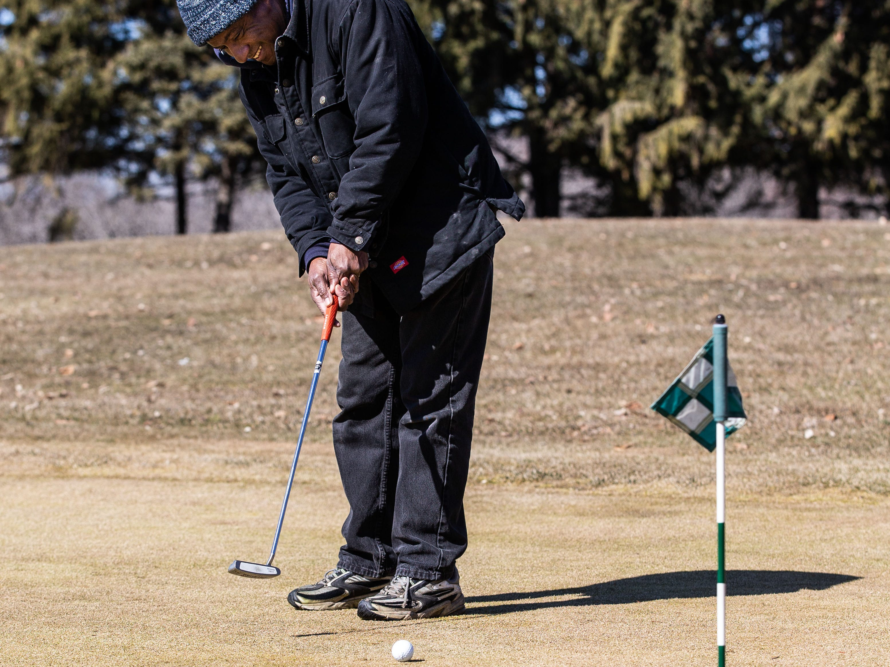 Charles Randolph of Glendale practices putting at Lincoln Park Golf Course in Glendale on Saturday, March 23, 2019. Warm sunny weather lured many enthusiasts outside to enjoy the game.