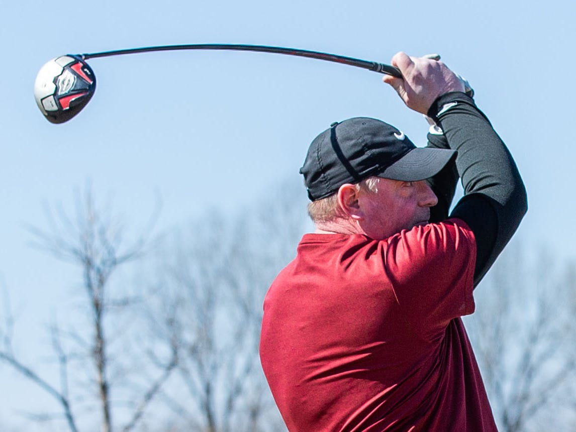 Mark Meyer of Waukesha drives off a tee at Moor Downs Golf Course in Waukesha on Saturday, March 23, 2019. Warm sunny weather lured many enthusiasts outside to enjoy the game.
