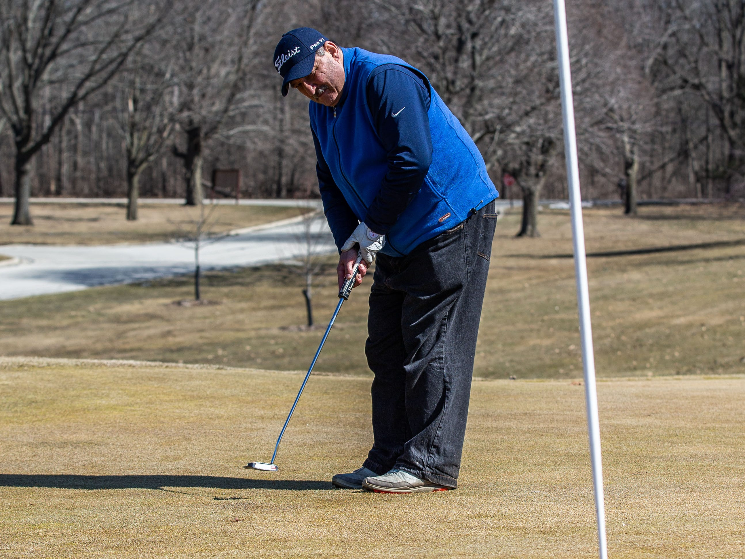 Jack Gabor of Greenfield sinks a putt at Whitnall Park Golf Course in Franklin on Saturday, March 23, 2019. Warm sunny weather lured many enthusiasts outside to enjoy the game.