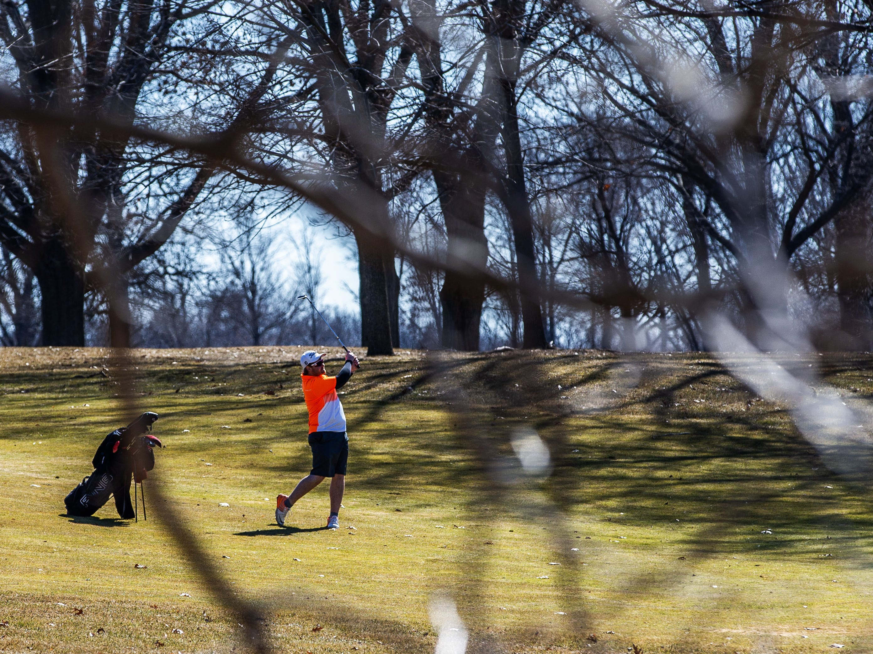 A golfer hits off a fairway at Whitnall Park Golf Course in Franklin on Saturday, March 23, 2019. Warm sunny weather lured many enthusiasts outside to enjoy the game.