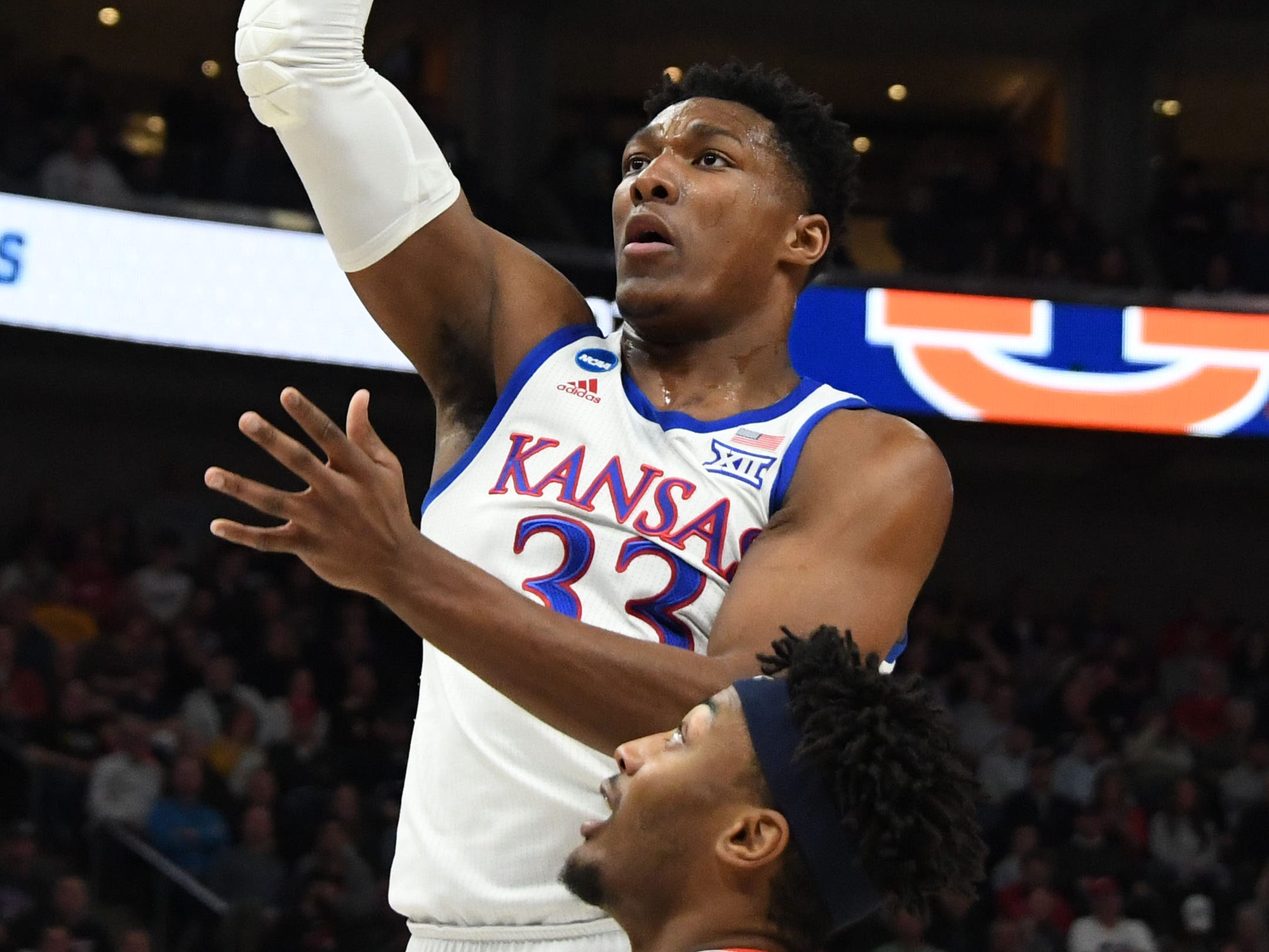 Mar 23, 2019; Salt Lake City, UT, USA; Kansas Jayhawks forward David McCormack (33) shoots as Auburn Tigers forward Anfernee McLemore (24) looks on during the first half in the second round of the 2019 NCAA Tournament at Vivint Smart Home Arena. Mandatory Credit: Kirby Lee-USA TODAY Sports