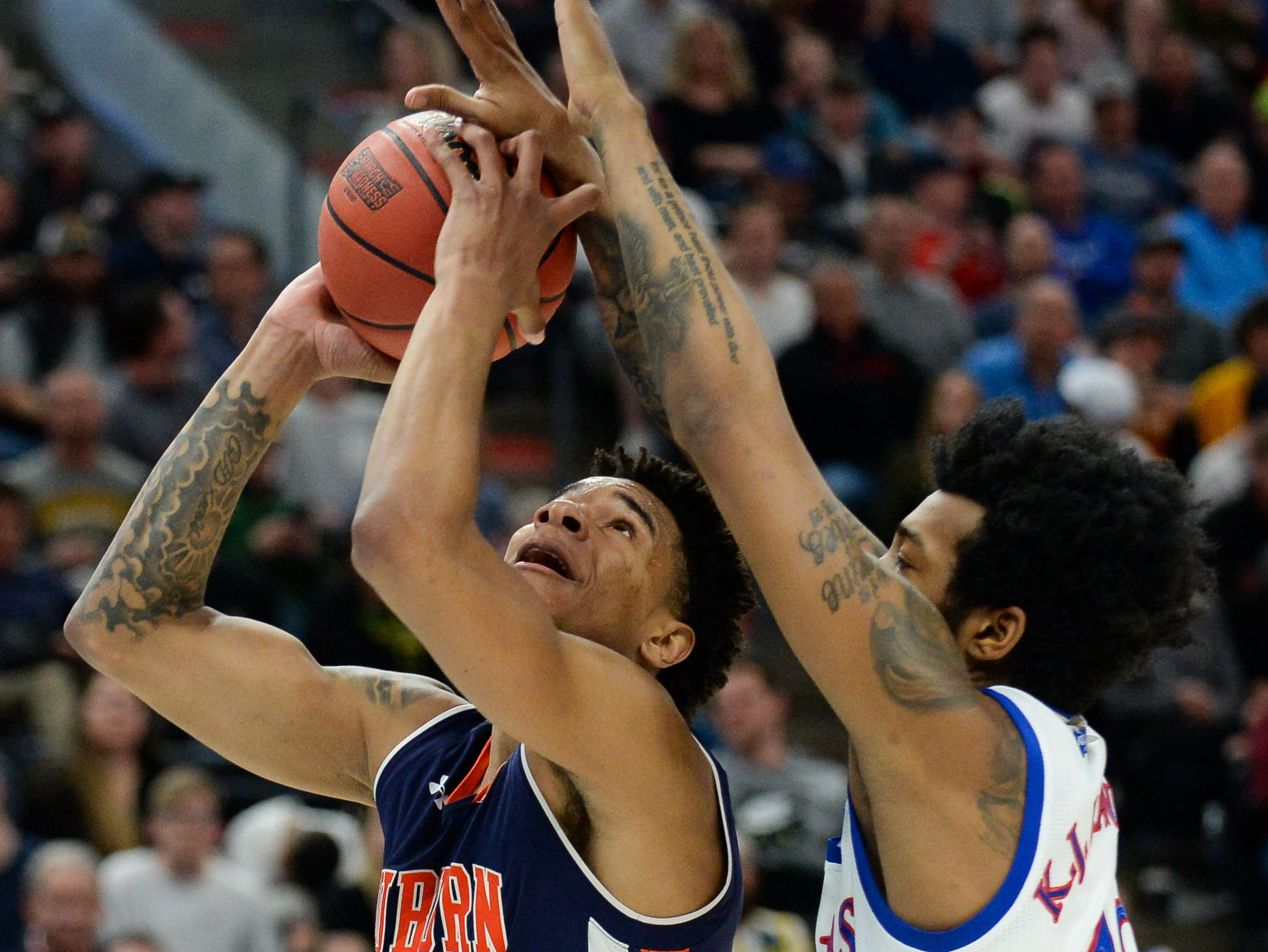 Mar 23, 2019; Salt Lake City, UT, USA; Auburn Tigers forward Chuma Okeke (5) looks to shoot as Kansas Jayhawks guard K.J. Lawson (13) defends during the first half in the second round of the 2019 NCAA Tournament at Vivint Smart Home Arena. Mandatory Credit: Gary A. Vasquez-USA TODAY Sports