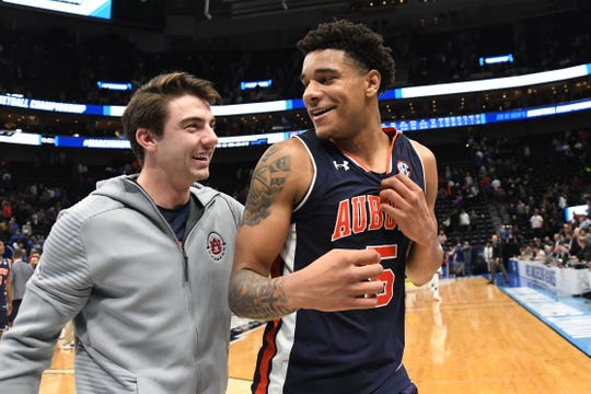Auburn forward Chuma Okeke (5) and guard Will Macoy celebrate a win over Kansas in the second round of the NCAA Tournament at Vivint Smart Home Arena. on March 23, 2019, in Salt Lake City.