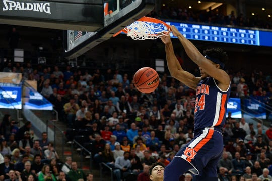 Mar 23, 2019; Salt Lake City, UT, USA; Auburn Tigers forward Anfernee McLemore (24) dunks during the first half in the second round of the 2019 NCAA Tournament against the Kansas Jayhawks at Vivint Smart Home Arena. Mandatory Credit: Gary A. Vasquez-USA TODAY Sports