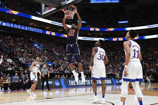 Auburn center Austin Wiley (50) dunks in front of of Kansas guards Ochai Agbaji (30) and Devon Dotson (11) in the second round of the 2019 NCAA Tournament at Vivint Smart Home Arena on March 23, 2019, in Salt Lake City.