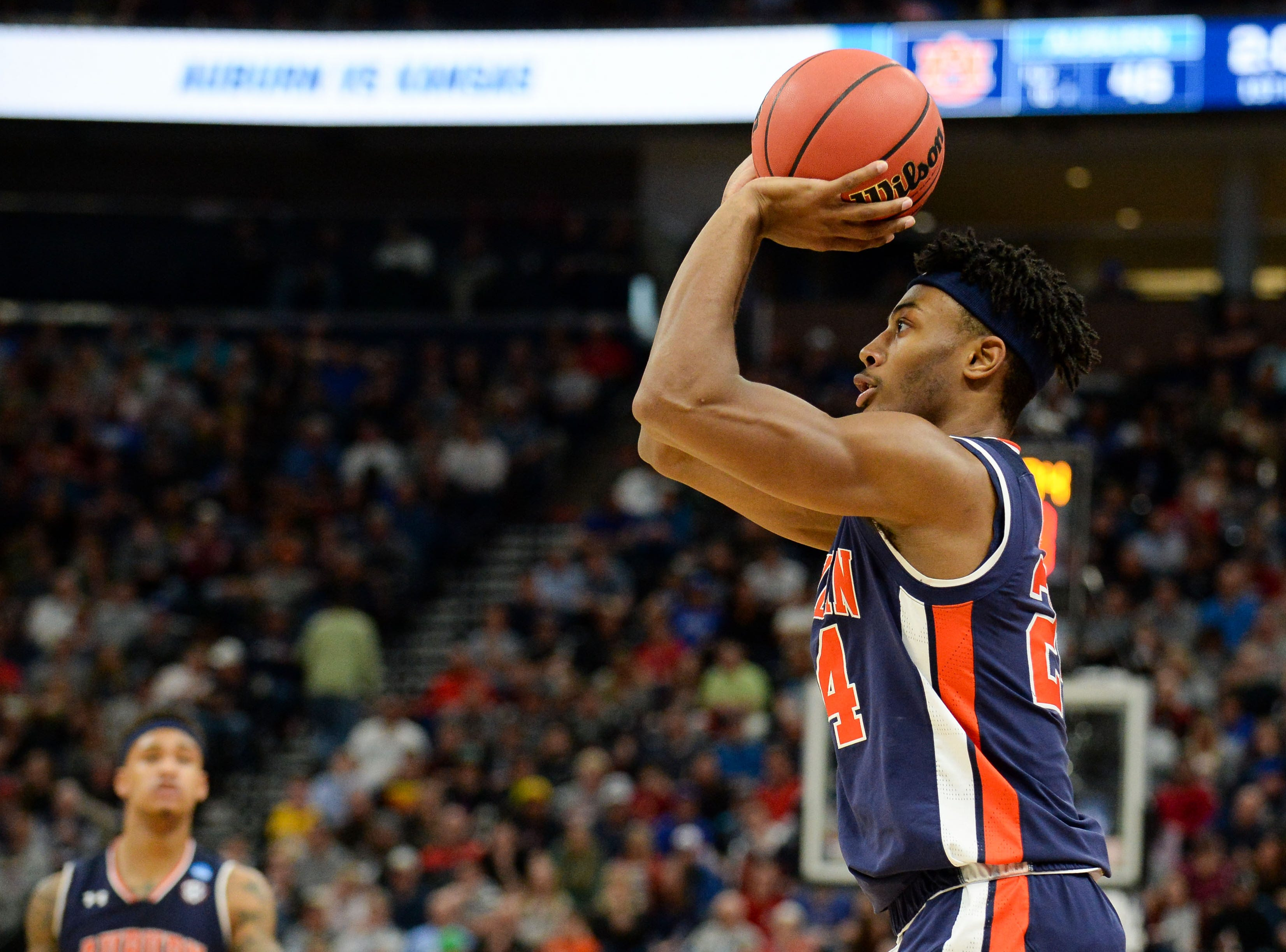 Mar 23, 2019; Salt Lake City, UT, USA; Auburn Tigers forward Anfernee McLemore (24) shoots a three-pointer during the first half in the second round of the 2019 NCAA Tournament against the Kansas Jayhawks at Vivint Smart Home Arena. Mandatory Credit: Gary A. Vasquez-USA TODAY Sports