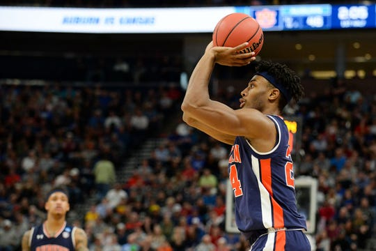 Auburn forward Anfernee McLemore (24) shoots a 3-pointer during an NCAA Tournament game against Kansas at Vivint Smart Home Arena on March 23, 2019, in Salt Lake City, Utah.