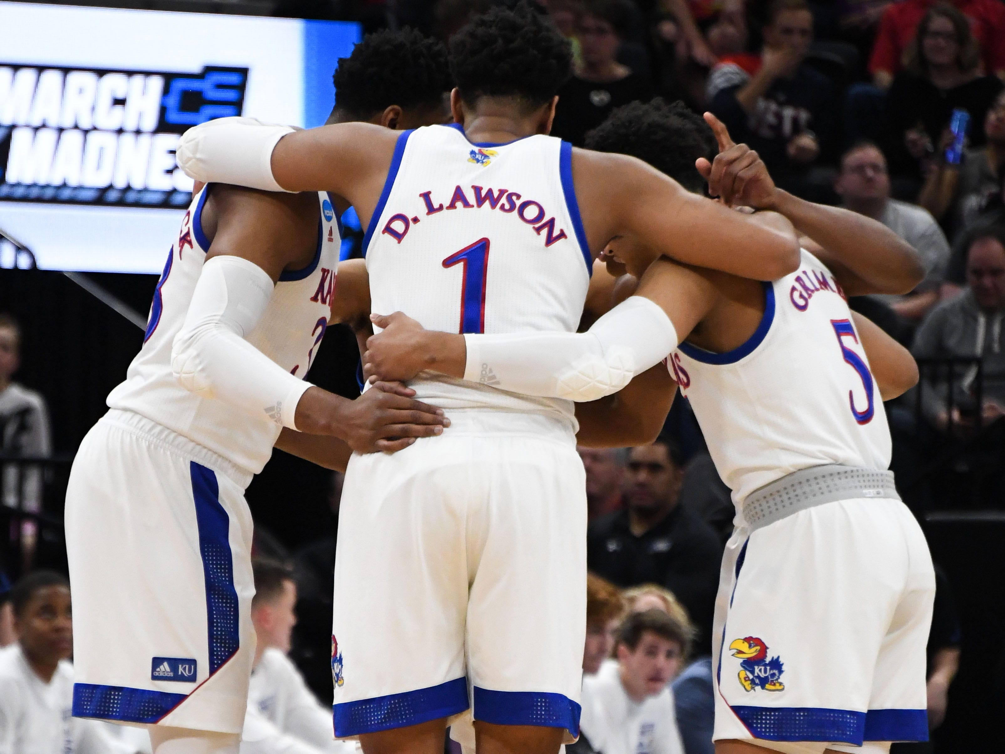 Mar 23, 2019; Salt Lake City, UT, USA; Kansas Jayhawks forward Dedric Lawson (1) huddles with teammates during the first half in the second round of the 2019 NCAA Tournament against the Auburn Tigers at Vivint Smart Home Arena. Mandatory Credit: Kirby Lee-USA TODAY Sports