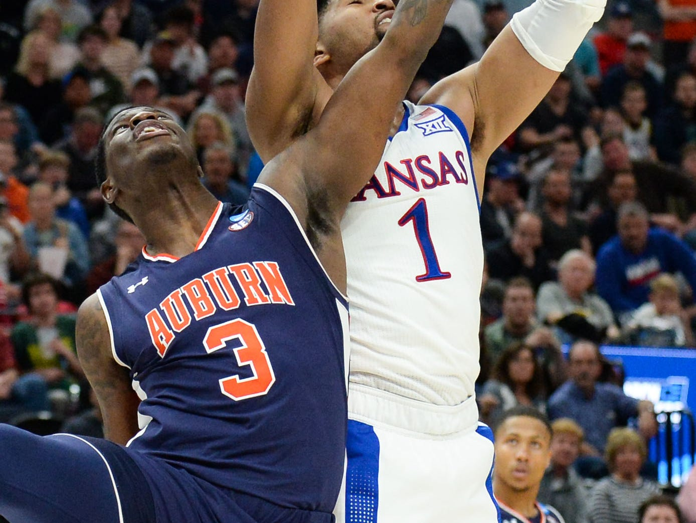 Mar 23, 2019; Salt Lake City, UT, USA; Kansas Jayhawks forward Dedric Lawson (1) grabs a rebound ahead of Auburn Tigers forward Danjel Purifoy (3) during the first half in the second round of the 2019 NCAA Tournament at Vivint Smart Home Arena. Mandatory Credit: Gary A. Vasquez-USA TODAY Sports
