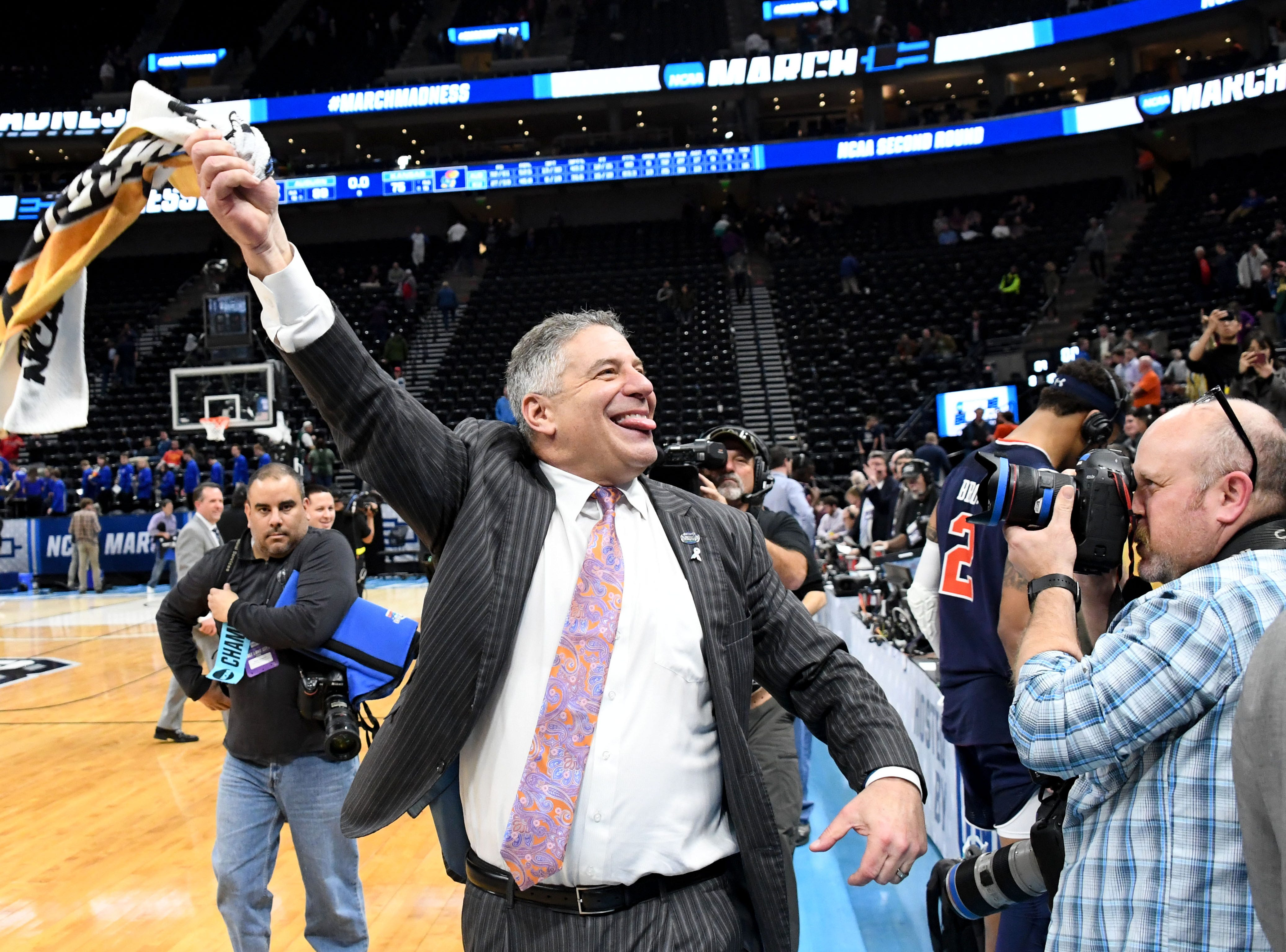 Auburn coach Bruce Pearl celebrates the win over the Kansas Jayhawks in the second round of the 2019 NCAA Tournament at Vivint Smart Home Arena on March 23, 2019, in Salt Lake City.