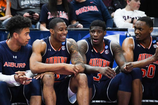 Auburn players Myles Parker, Horace Spencer, Danjel Purifoy and Austin Wiley (from left to right) react on the bench during the second half of a win over Kansas in the NCAA Tournament at Vivint Smart Home Arena on March 23, 2019, in Salt Lake City.