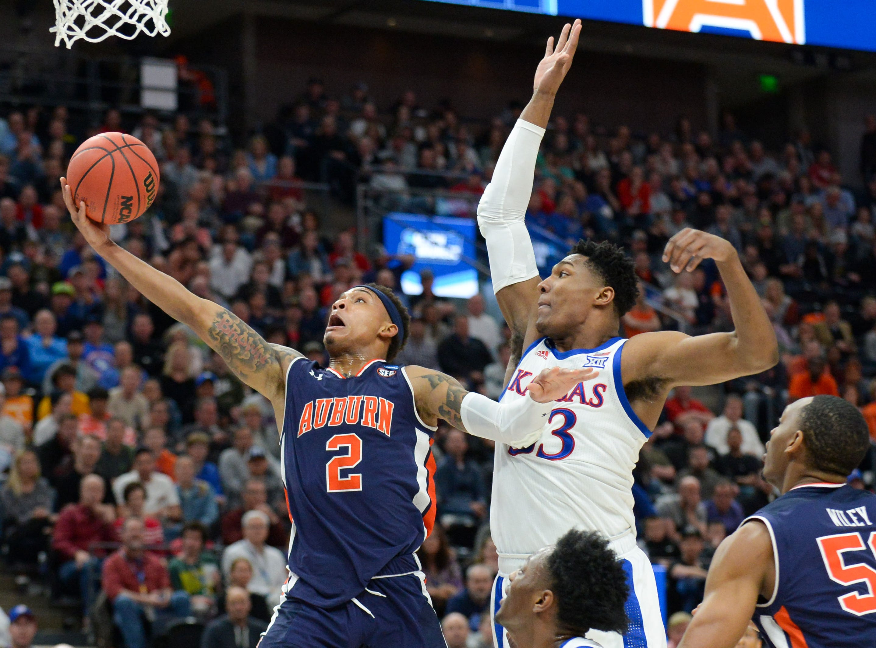 Mar 23, 2019; Salt Lake City, UT, USA; Auburn Tigers guard Bryce Brown (2) goes up for a shot as Kansas Jayhawks forward David McCormack (33) defends during the first half in the second round of the 2019 NCAA Tournament at Vivint Smart Home Arena. Mandatory Credit: Gary A. Vasquez-USA TODAY Sports