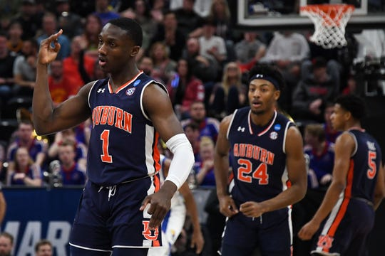 Auburn guard Jared Harper (1) reacts after making a 3 against Kansas in the second round of the NCAA Tournament at Vivint Smart Home Arena on March 23, 2019 in Salt Lake City.