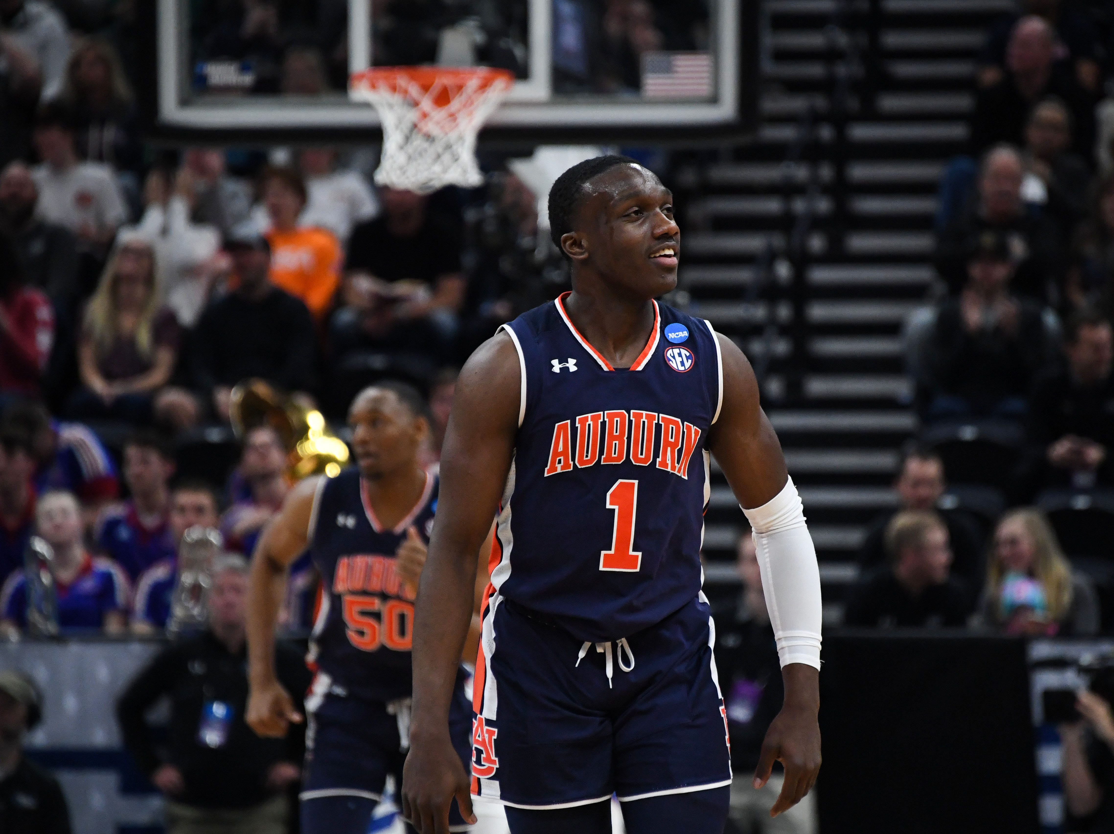 Mar 23, 2019; Salt Lake City, UT, USA; Auburn Tigers guard Jared Harper (1) reacts during the first half in the second round of the 2019 NCAA Tournament against the Kansas Jayhawks at Vivint Smart Home Arena. Mandatory Credit: Kirby Lee-USA TODAY Sports