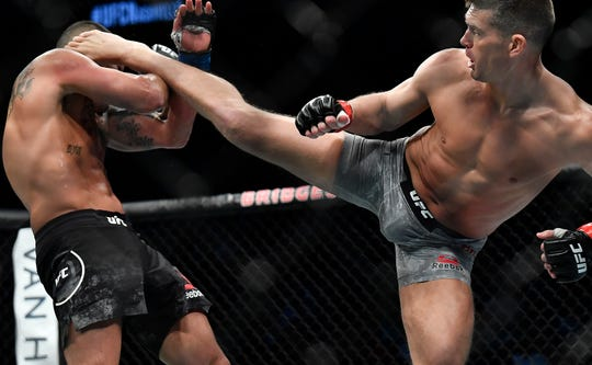 Anthony Pettis takes a kick from Stephen Thompson in their welterweight bout during UFC Fight Night 148 at Bridgestone Arena Saturday, March 23, 2019 in Nashville, Tenn.