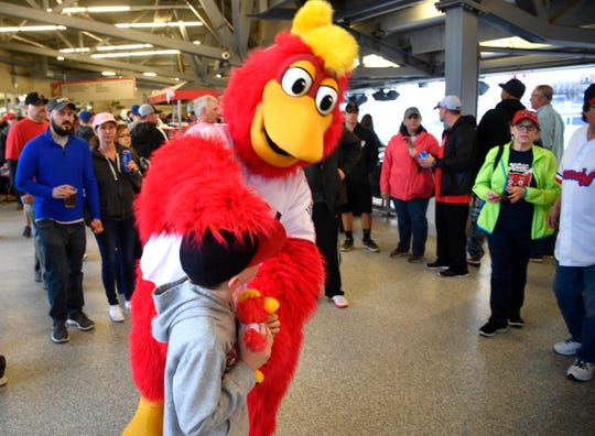 Booster greets fans during the Nashville Sounds' exhibition game against the Texas Rangers on March 24.
