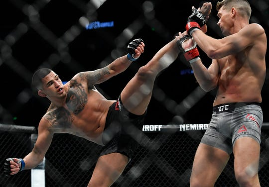 Anthony Pettis kicks Stephen Thompson in their welterweight bout during UFC Fight Night 148 at Bridgestone Arena Saturday, March 23, 2019 in Nashville, Tenn.