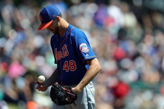 Mar 23, 2019; Lake Buena Vista, FL, USA; New York Mets starting pitcher Jacob deGrom (48) prepares to throw the ball against the Atlanta Braves in the second inning at Champion Stadium.