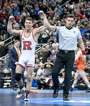 Mar 23, 2019; Pittsburgh, PA, USA; Rutgers wrestler Nick Suriano (white) reacts after defeating Oklahoma State wrestler Daton Fix (not pictured) in the finals of the 133 pound weight class during the NCAA Wrestling Championships at PPG Paints Arena.