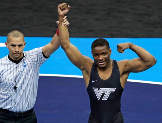 Virginia Tech's Mekhi Lewis, right, celebrates his win over Penn State's Vincenzo Joseph in their 165-pound bout in the finals of the NCAA wrestling championships Saturday, March 23, 2019, in Pittsburgh. Lewis, of Bound Brook, becomes the Hokies' first national champion.